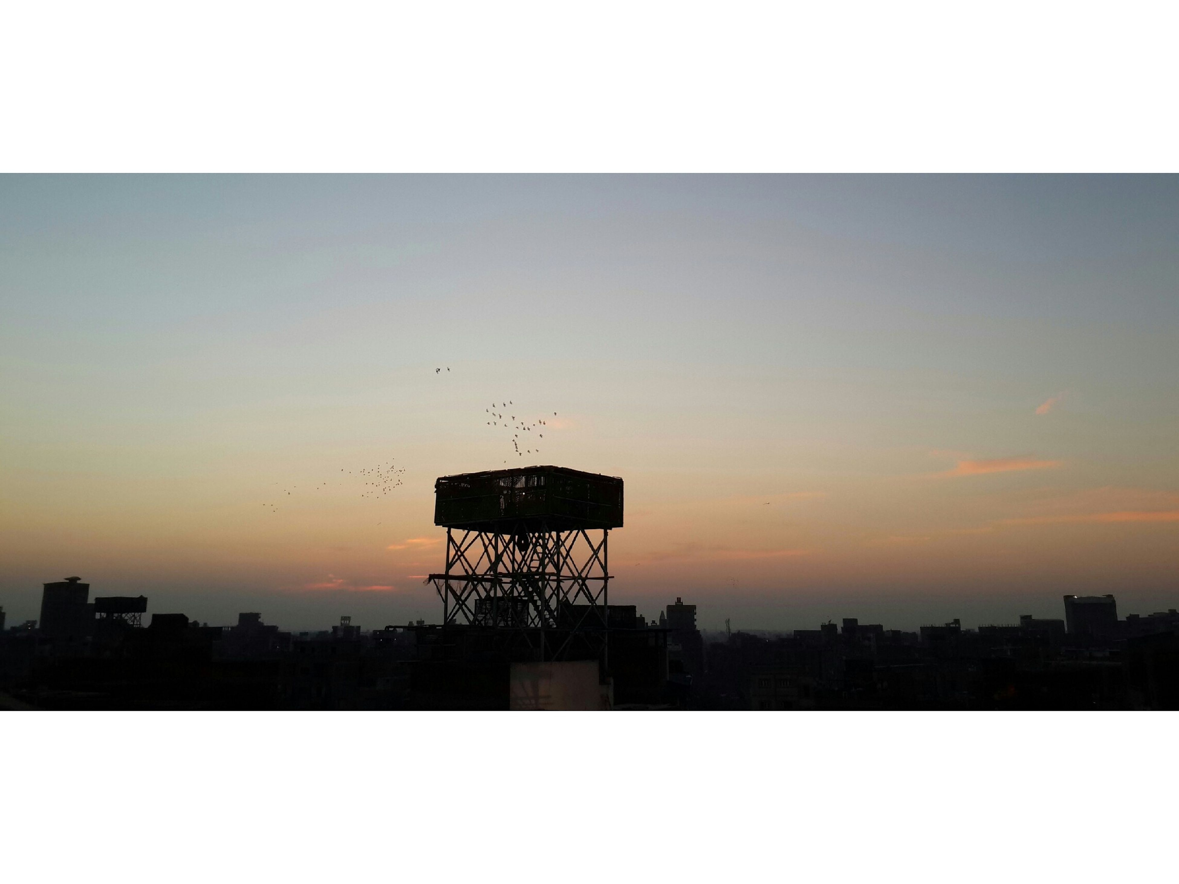 sunset, silhouette, built structure, architecture, water tower - storage tank, building exterior, sky, storage tank, water tank, outdoors, no people, nature, city, day