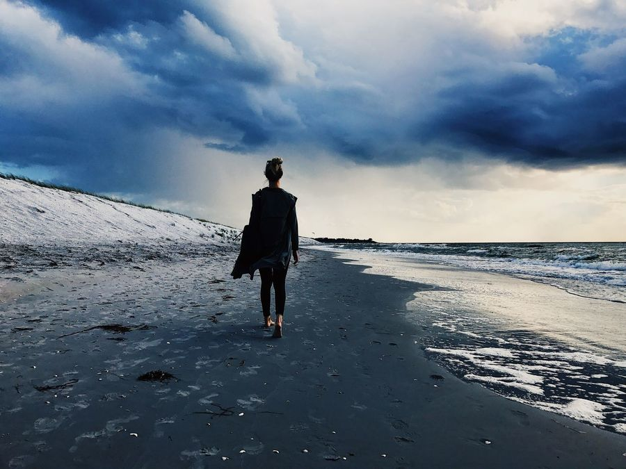 Sky Sea Beach Nature Full Length Beauty In Nature Rear View Walking Cloud - Sky Real People One Person Scenics Sand Water Horizon Over Water Tranquil Scene Outdoors Lifestyles Tranquility Leisure Activity