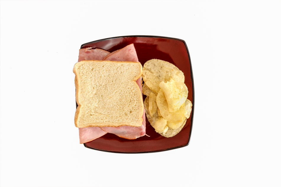 Ham sandwich and chips on a plate with white background. Bread Close-up Convenience Food Food Food And Drink Freshness Ham Sandwich Healthy Eating Indoors  No People Ready-to-eat Sandwich Studio Shot White Background