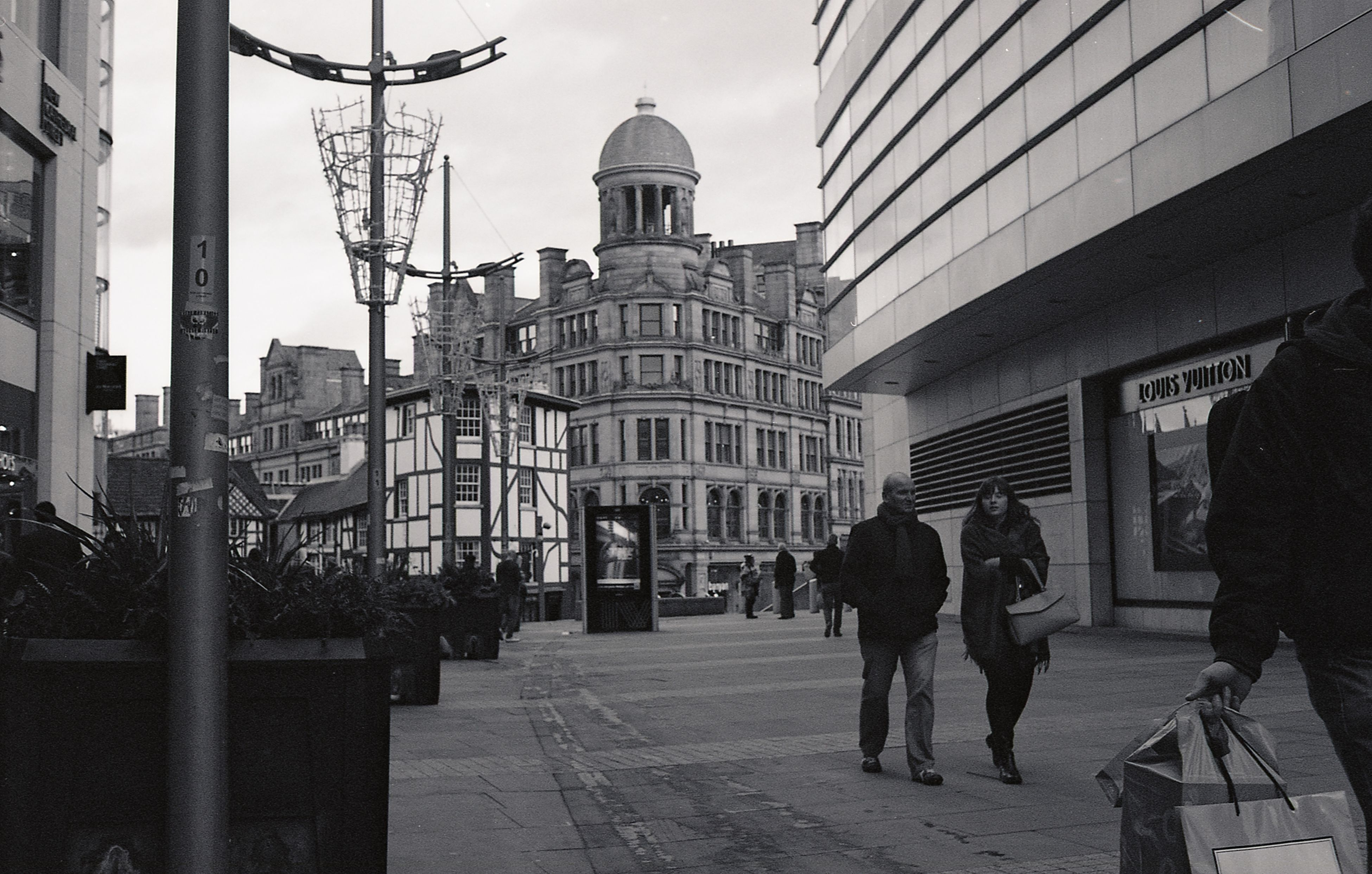 building exterior, architecture, built structure, city, men, walking, street, city life, person, lifestyles, building, day, leisure activity, sky, full length, incidental people, outdoors, rear view, communication