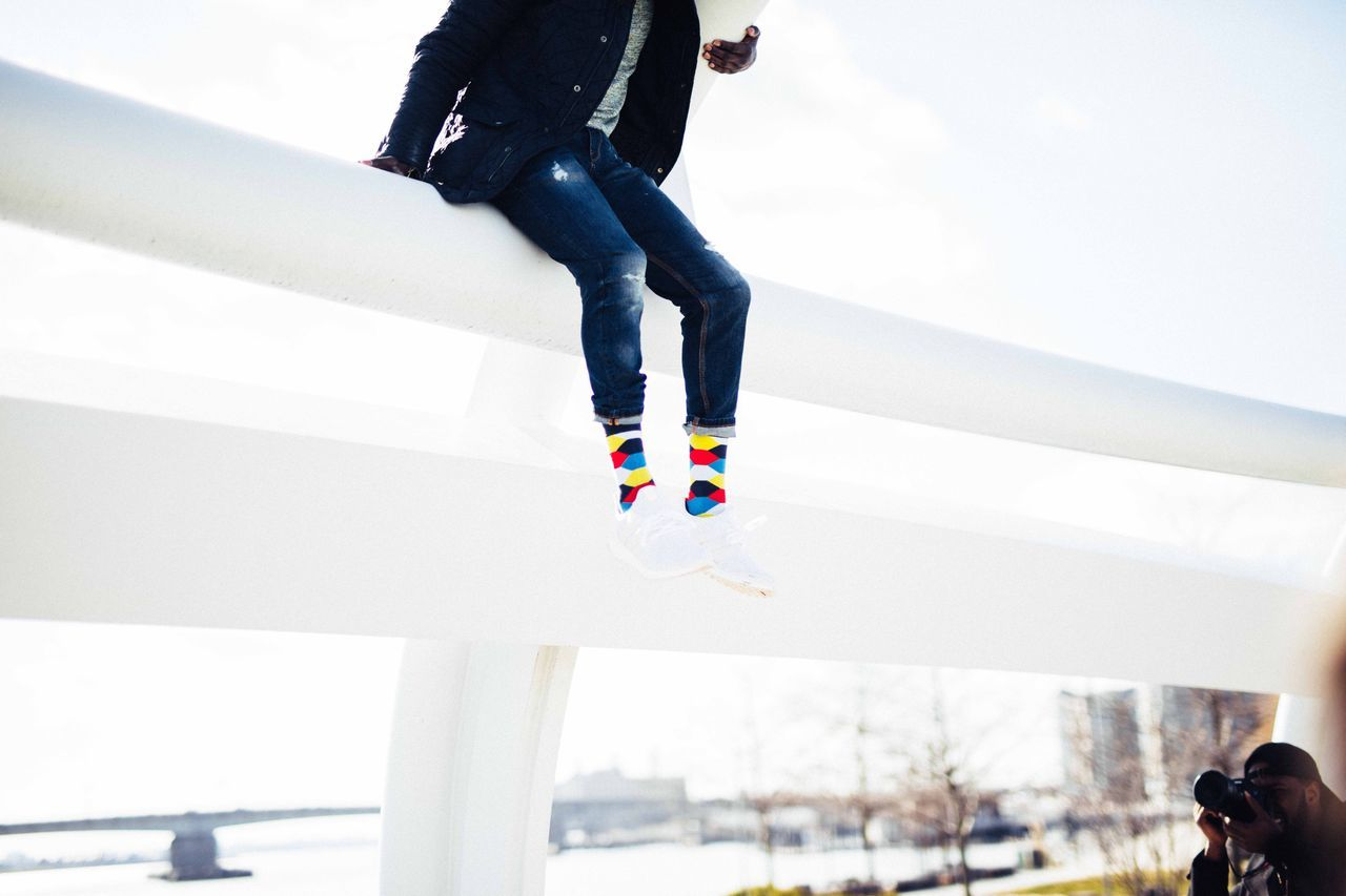 Hanging around. Real People Casual Clothing Low Section One Person Lifestyles Leisure Activity Multi Colored Day Human Body Part Human Leg Outdoors Human Hand Socks Socksoftheday Colorful Socks Adapted To The City