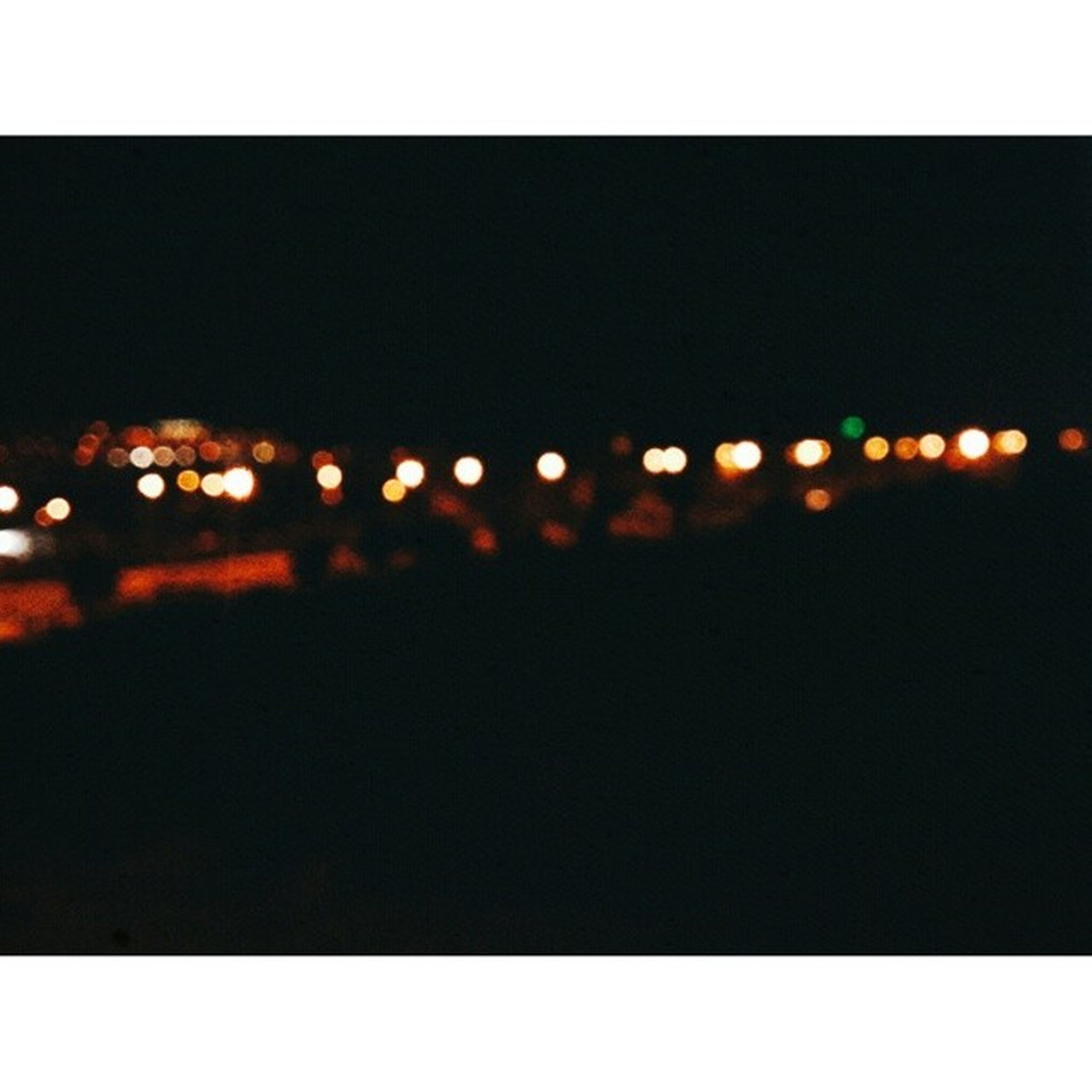 illuminated, transfer print, night, auto post production filter, copy space, dark, light - natural phenomenon, defocused, lighting equipment, glowing, no people, light, outdoors, clear sky, pattern, reflection, water, orange color, nature, yellow