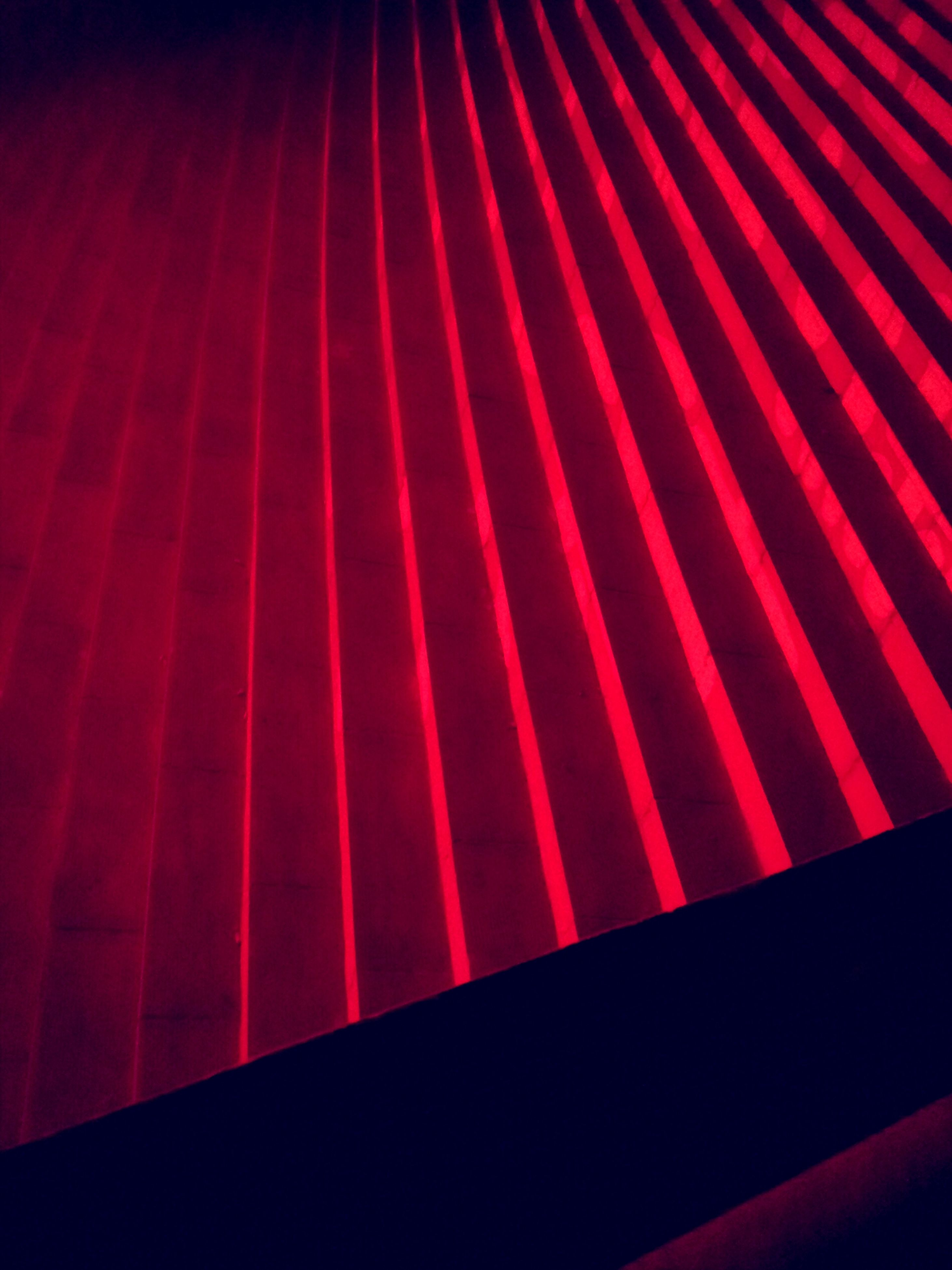 red, indoors, pattern, backgrounds, full frame, close-up, no people, striped, illuminated, night, abstract, design, vibrant color, multi colored, textured, high angle view, detail, pink color, in a row, dark