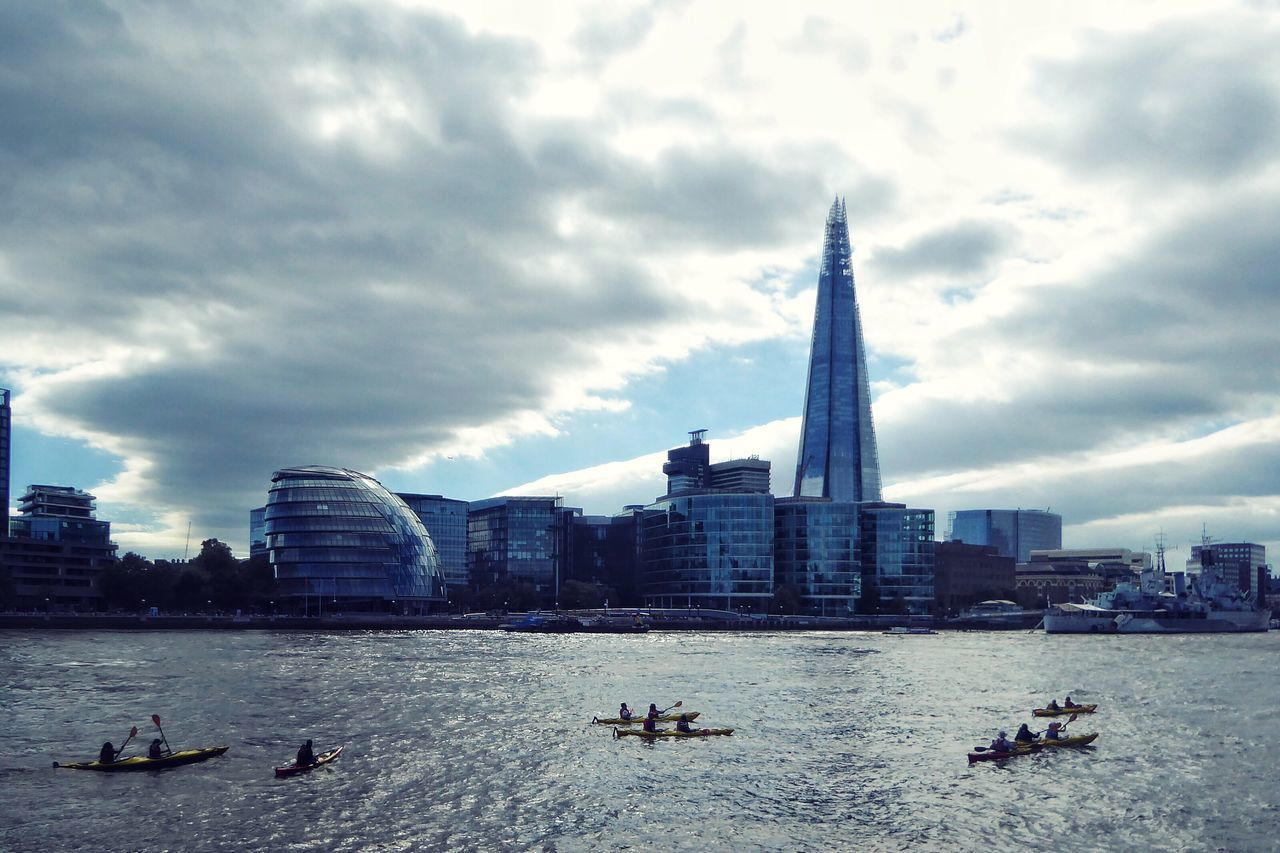 Paddling down the River Thames in Canoes . London Water Architecture Sky Cloud - Sky Travel Destinations Transportation City Waterfront Outdoors Modern Men Skyscraper Thames River Canoe Canoeing Kayaking Kayak Adapted To The City London Lifestyle EyeEmNewHere