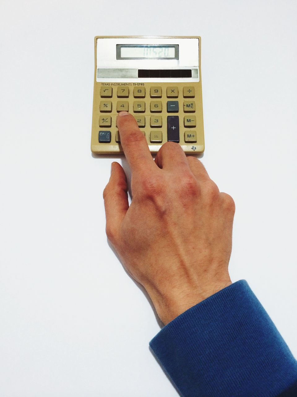 High angle view of man using old calculator against white background