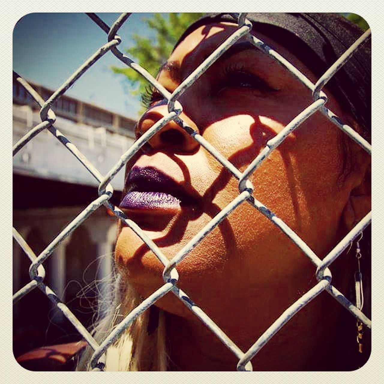 chainlink fence, safety, protection, danger, metal, one person, barbed wire, adult, cage, adults only, young adult, human face, outdoors, people, headshot, escape, day, close-up, only men, men, real people, one man only, mammal, young women