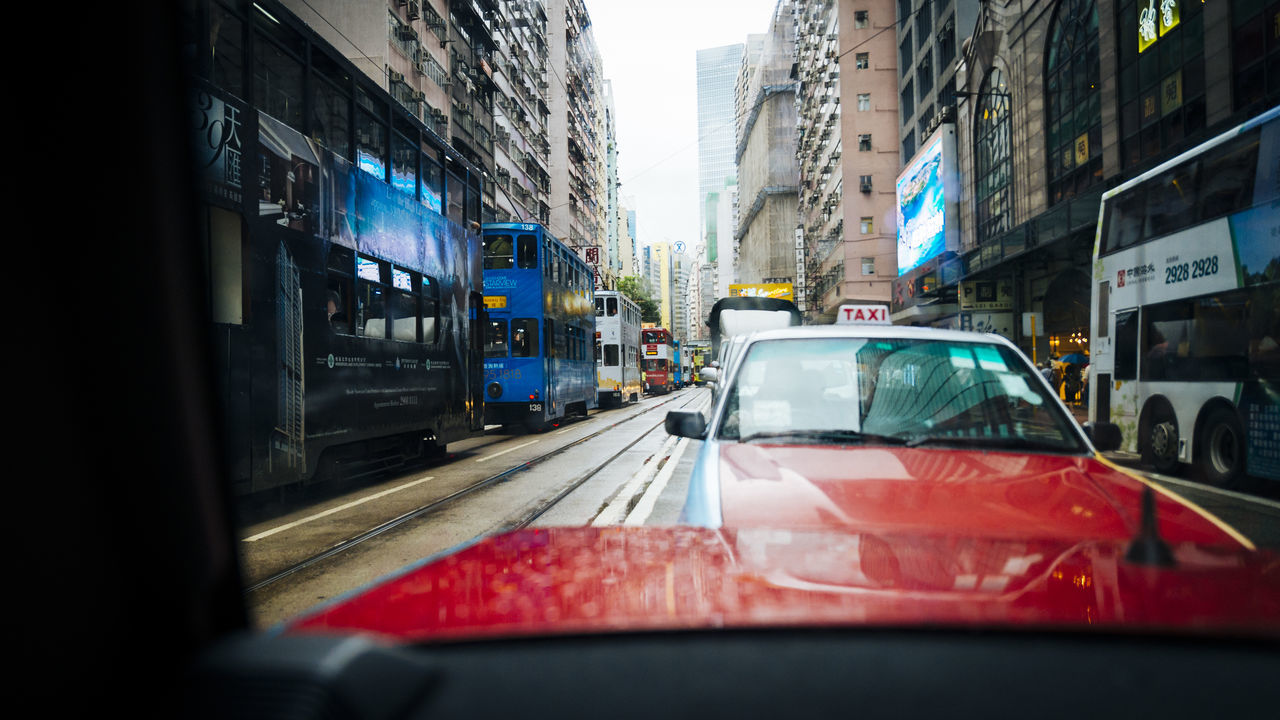 Downtown Hong Kong. building exterior Cars City City City Life City Street Cityscape climate change environment landmark mode of transport no people Public Transportation Rearview Red street tracks Traffic Tram Transportation Transportation travel destinations urban viewpoint window