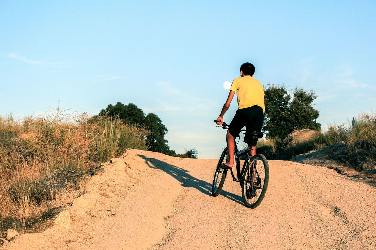 Beautiful stock photos of fahrrad, bicycle, one person, real people, rear view