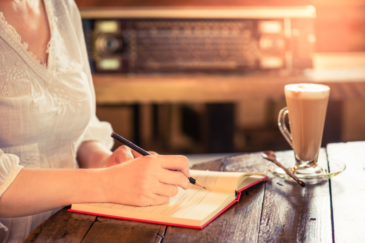 Working woman at vintage style coffee shop. Start fresh new working day with tasty coffee,pencil and note Book Close-up Coffee - Drink Day Diary Drink Focus On Foreground Food And Drink Holding Human Body Part Human Hand Indoors  Lifestyles Occupation One Person Paper Pen People Real People Sitting Table Women Working Writing