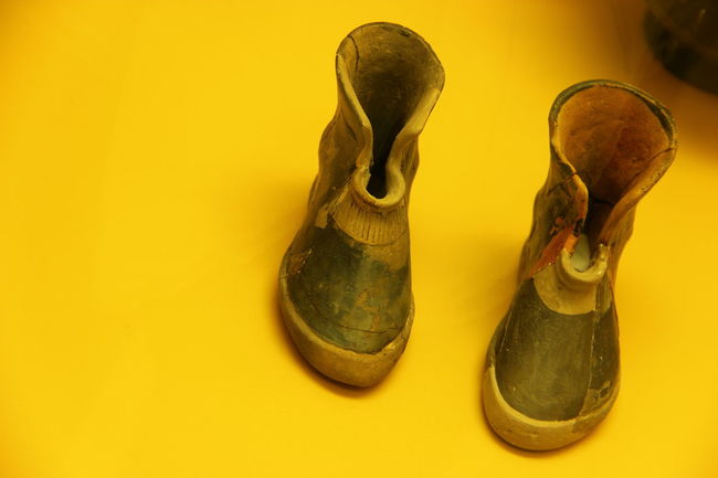 Two are better than one when in a glass case Acropolis Agora Ancient Civilization Artifact Athens Boot Childhood Close-up Footwear Greece GREECE ♥♥ Indoors  Man Made Object Museum Museum Display Museum Piece Pair Shoe Shoe Shoelace Still Life String Instrument Two Is Better Than One Wall - Building Feature Yellow