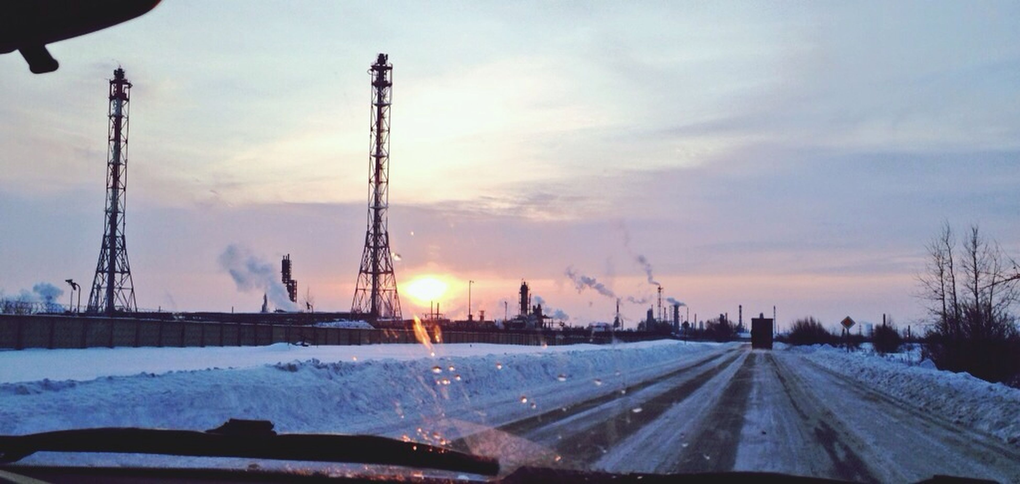 snow, cold temperature, winter, sunset, sky, weather, season, frozen, cloud - sky, electricity pylon, transportation, nature, fuel and power generation, electricity, covering, outdoors, no people, beauty in nature, road, crane - construction machinery