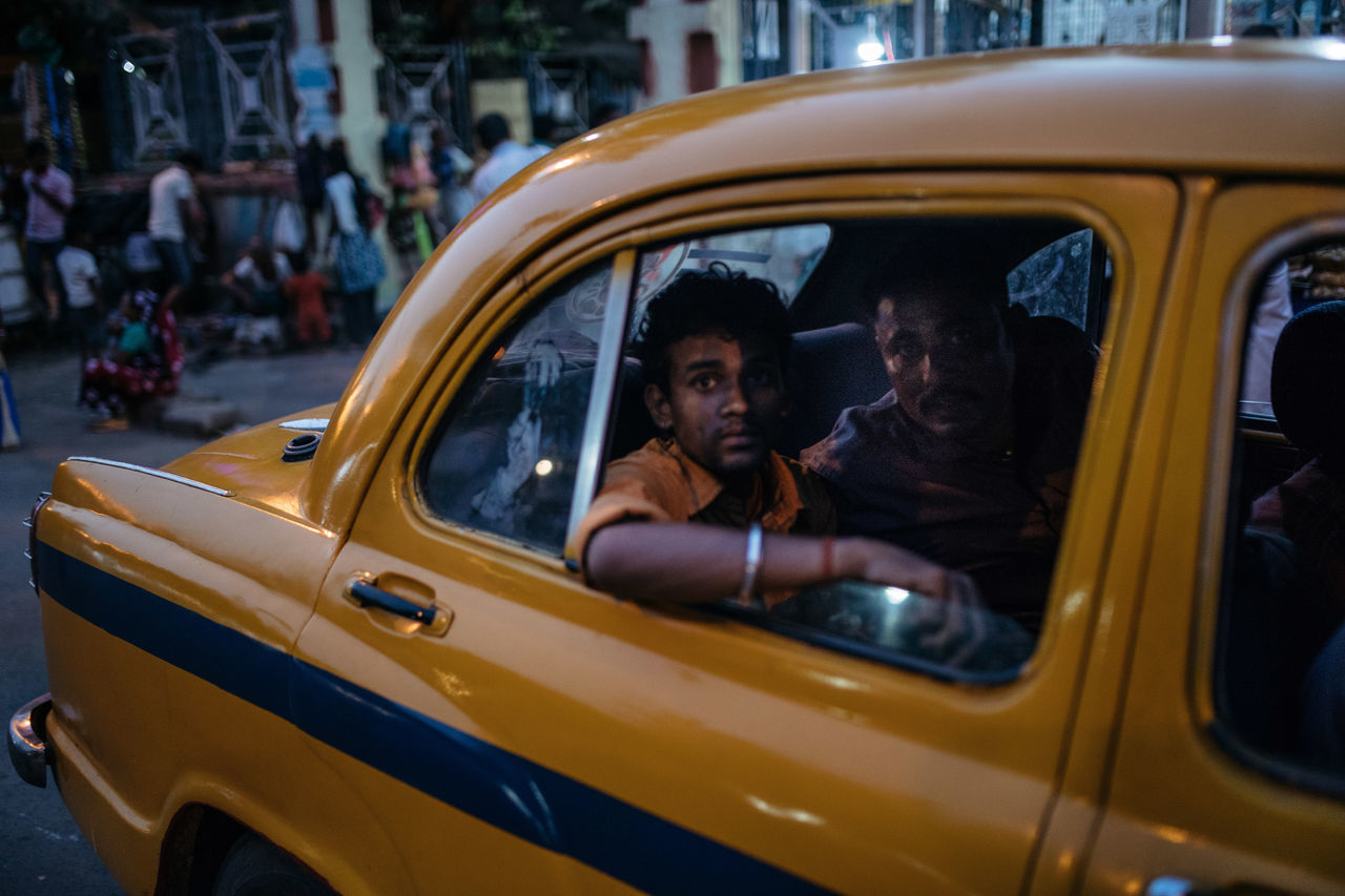 Car Car Door Incredible India India Kolkata Mode Of Transport Taxi The Portraitist - 2017 EyeEm Awards The Street Photographer - 2017 EyeEm Awards Two People Window Yellow Yellow Taxi BYOPaper! BYOPaper!