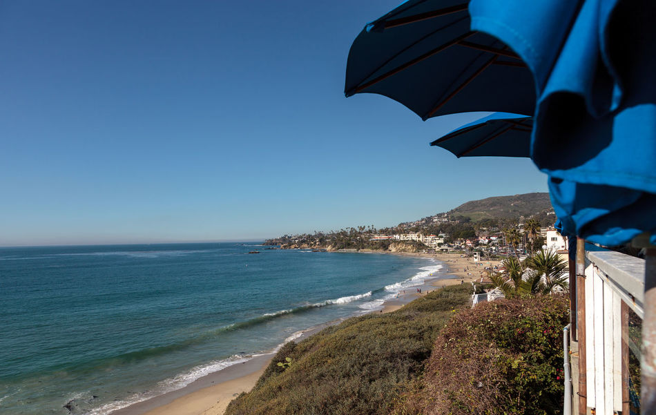 View of Main Beach in Laguna Beach from a restaurant under an umbrella Beach Beauty In Nature Coastline Day Horizon Over Water Laguna Beach, CA Nature No People Ocean Outdoors Sand Scenics Sea Sea And Sky Sky Tranquility Travel Destinations Vacations Water