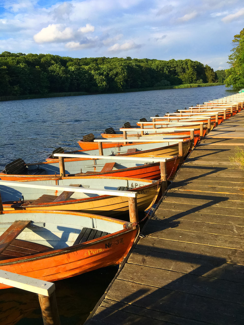 Boats Moored On Riverbank