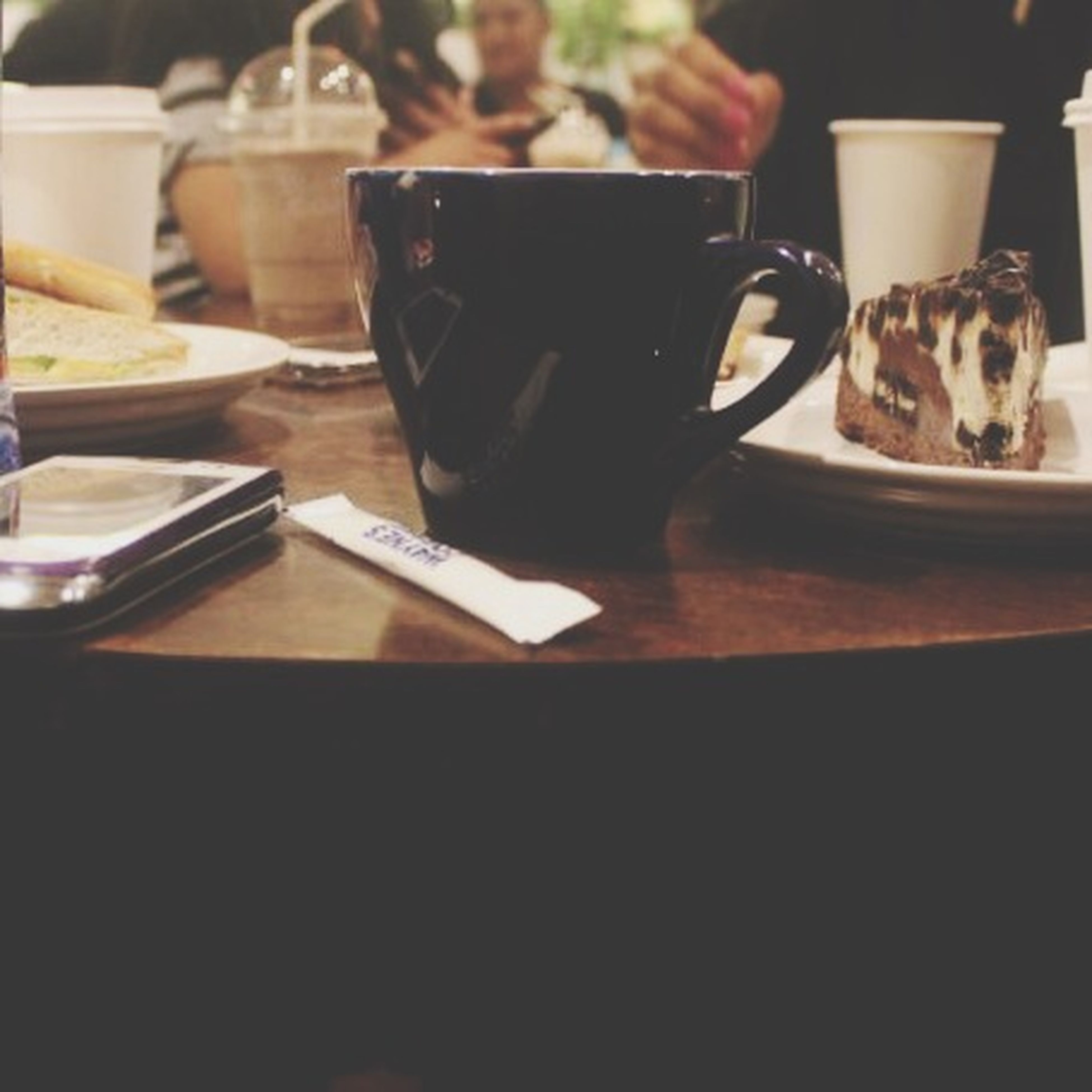 indoors, table, food and drink, drink, still life, coffee cup, close-up, refreshment, focus on foreground, coffee - drink, plate, cup, home interior, no people, chair, selective focus, restaurant, pets, freshness, high angle view