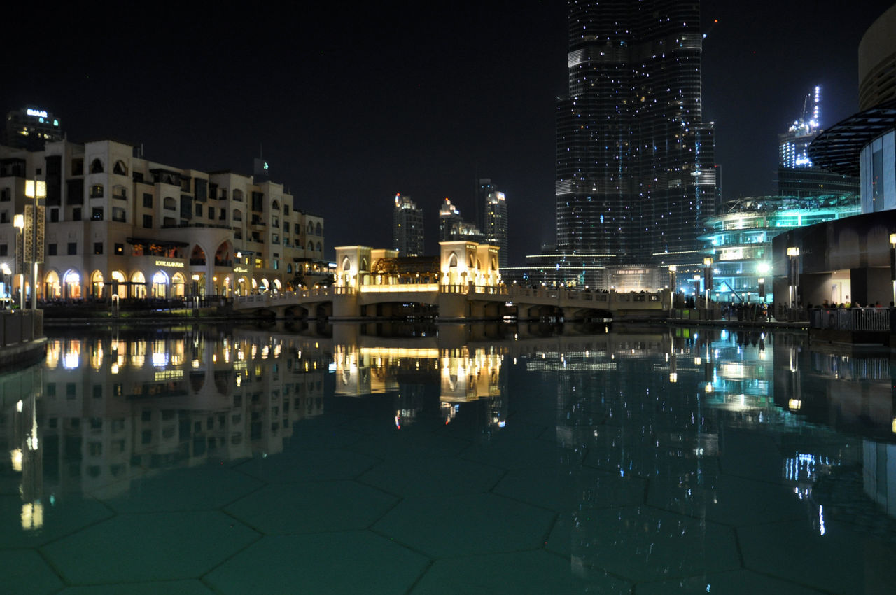 architecture, building exterior, built structure, reflection, night, illuminated, water, city, travel destinations, waterfront, outdoors, no people, sky, cityscape