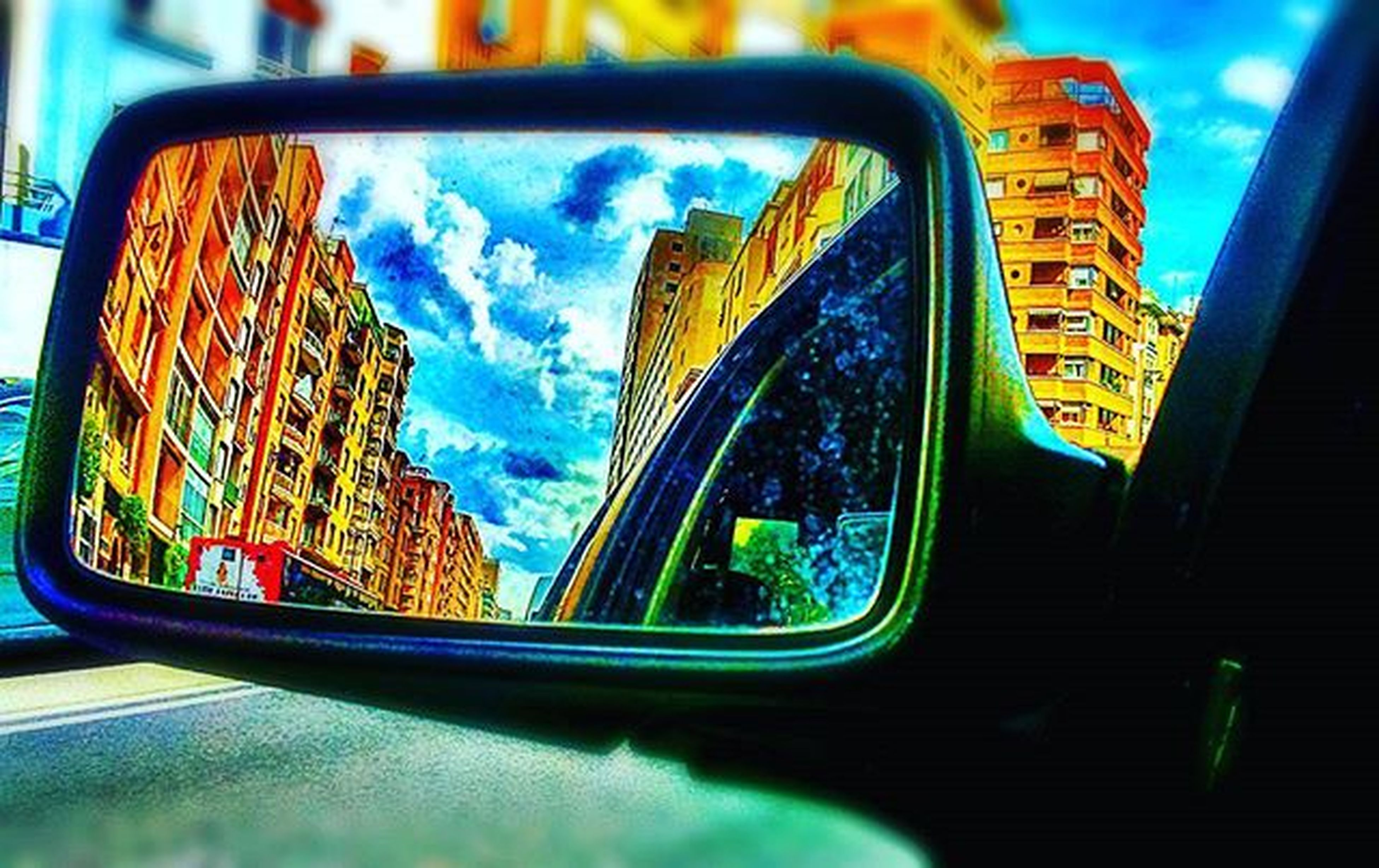 window, reflection, transportation, car, no people, day, low angle view, architecture, multi colored, sky, city, outdoors, close-up
