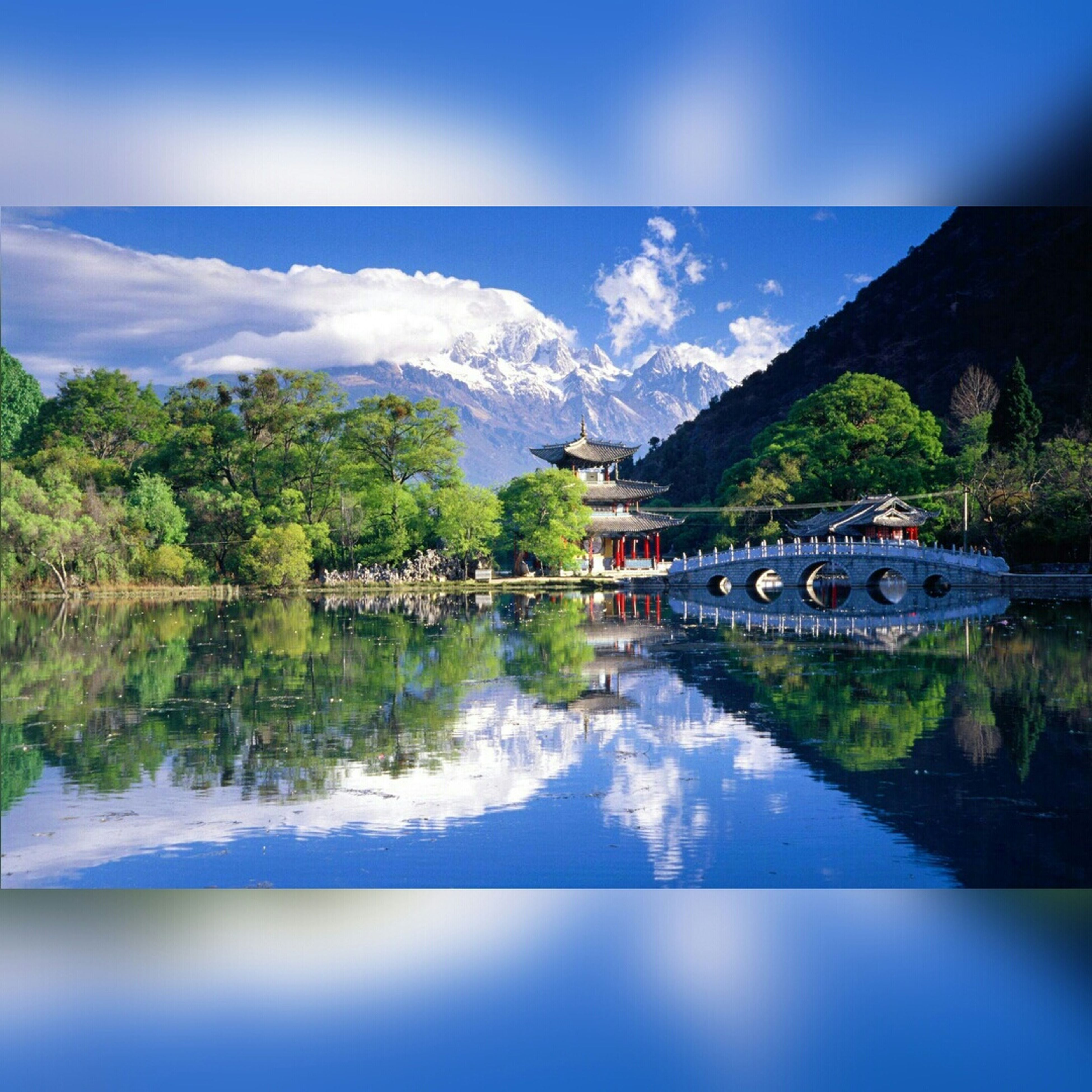 water, mountain, sky, reflection, scenics, tranquil scene, beauty in nature, tranquility, nature, blue, lake, waterfront, tree, transportation, cloud - sky, landscape, cloud, river, day, idyllic