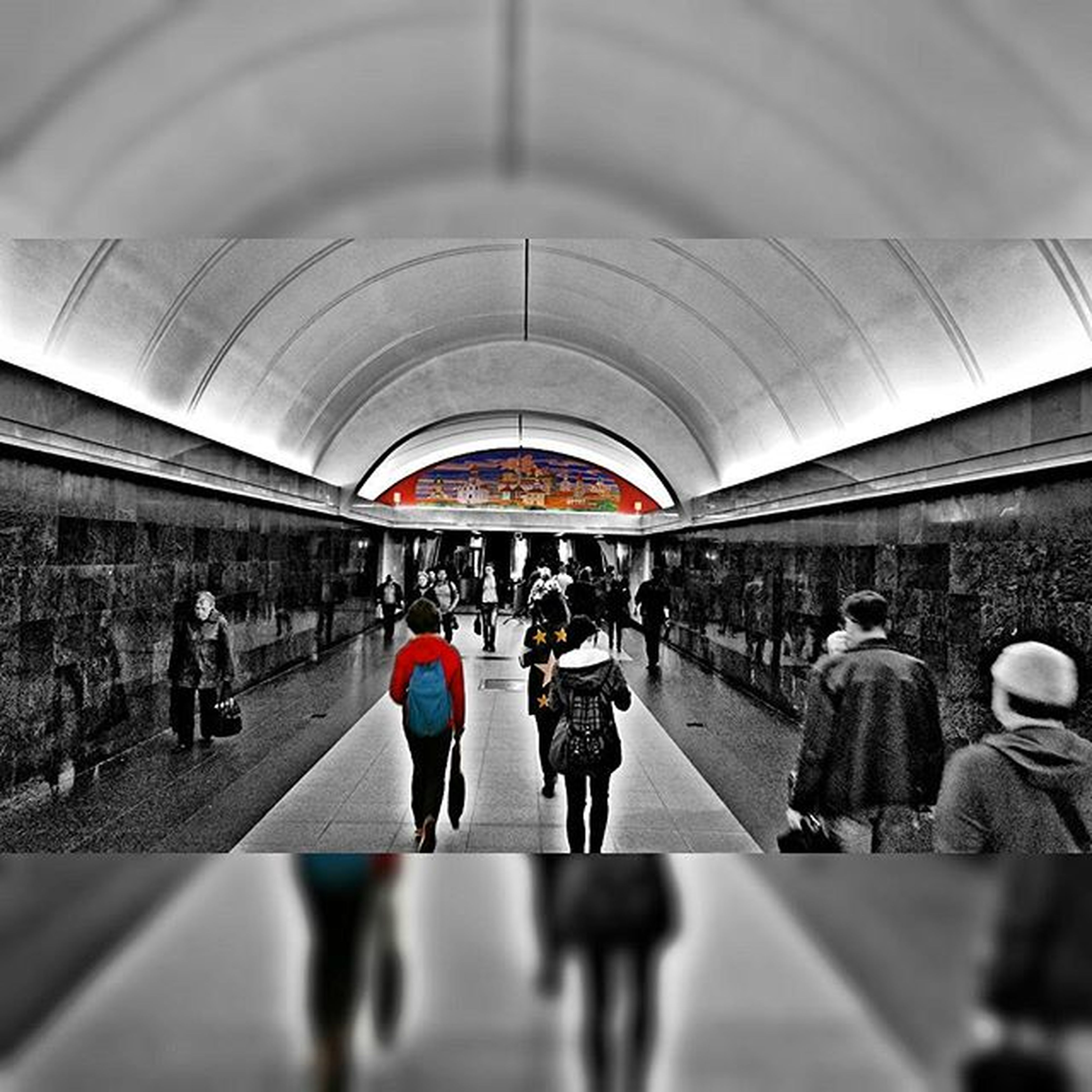 large group of people, men, indoors, architecture, person, built structure, walking, lifestyles, city life, railroad station, ceiling, leisure activity, travel, arch, public transportation, mixed age range, transportation, city, subway station
