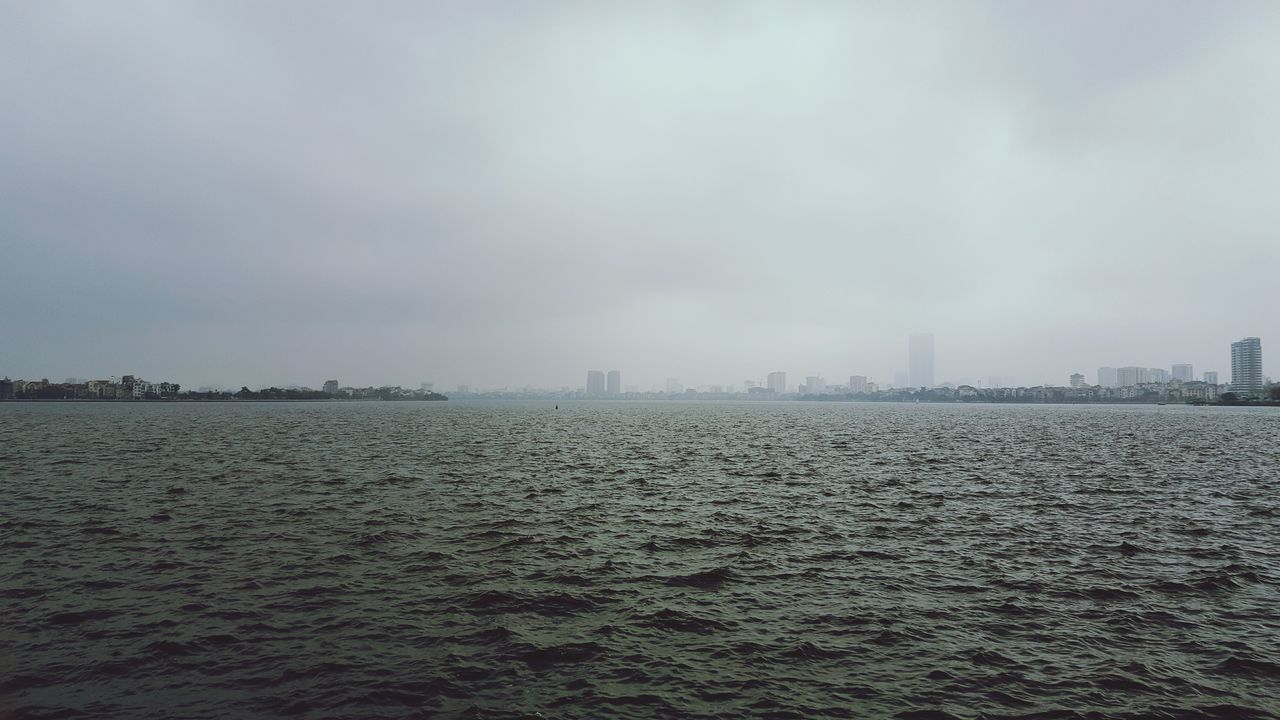 skyscraper, city, architecture, building exterior, built structure, cityscape, waterfront, urban skyline, sky, outdoors, no people, day, modern, nature, water, beauty in nature, fog, tranquility, travel destinations, scenics