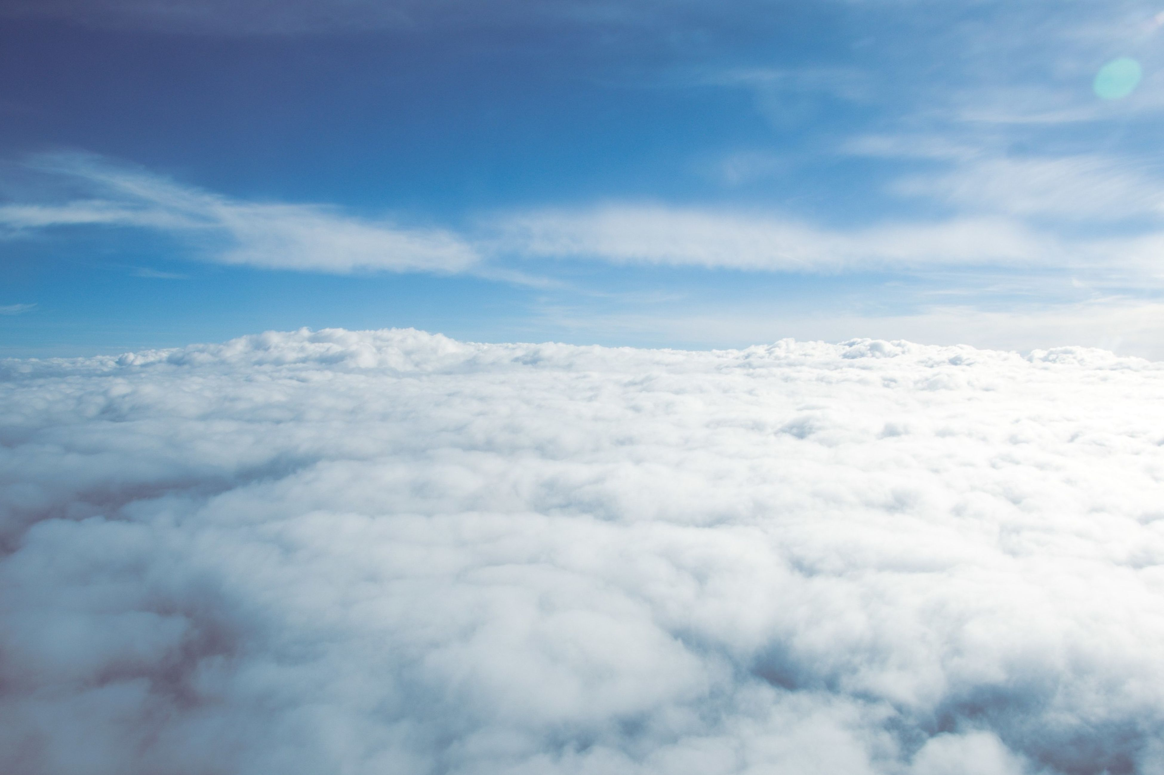 scenics, sky, beauty in nature, tranquil scene, tranquility, cloud - sky, nature, white color, cloudscape, weather, cloudy, cloud, idyllic, blue, sky only, majestic, aerial view, mountain, day, white