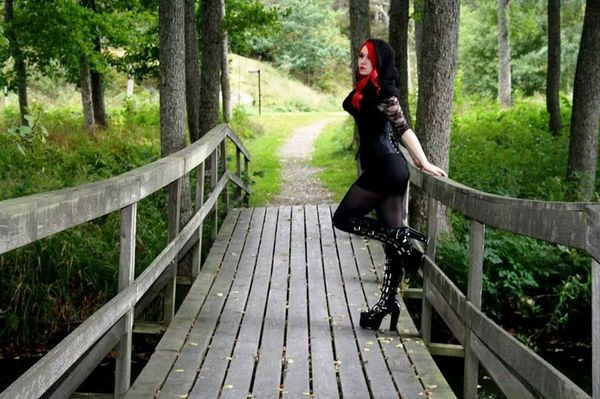 Black Riding Hood. Running in the woods. Hunting the wolf. Redhead Nature Corset Boots