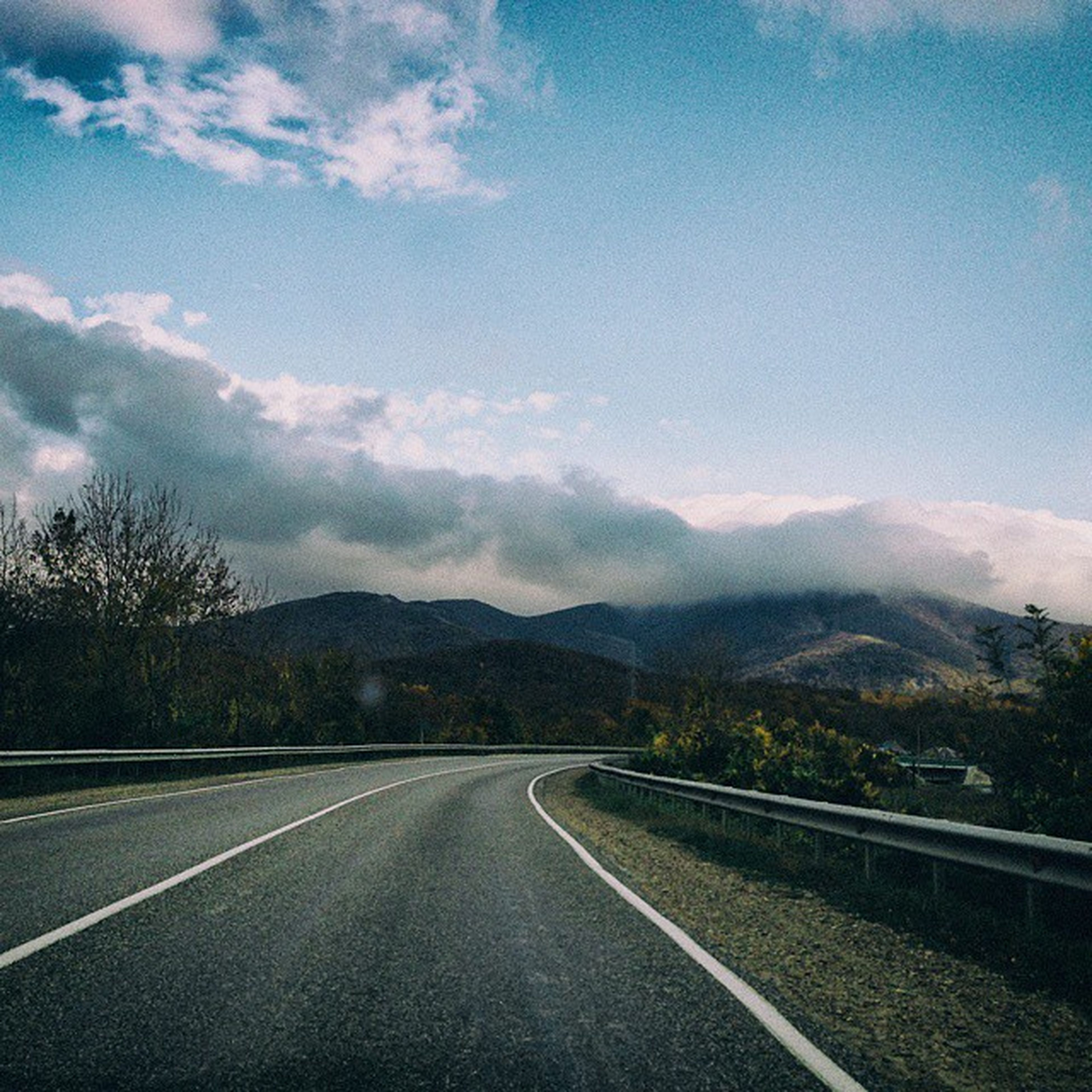 mountain, the way forward, road, sky, transportation, mountain range, diminishing perspective, road marking, landscape, cloud - sky, country road, cloud, vanishing point, tranquil scene, tranquility, tree, blue, scenics, nature, empty