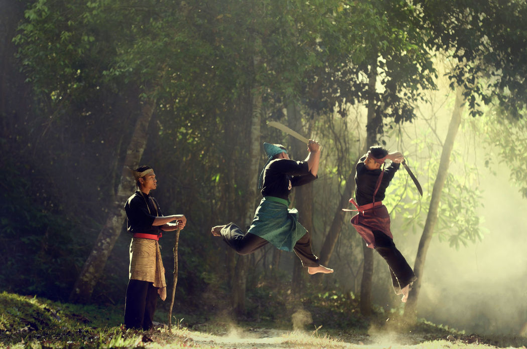 Silat Martial Art Practicing and Fighting to become stronger Asian  Break The Mold Day Fight Guru INDONESIA Malaysian Martial Arts Master Nature Outdoors Practicing Real People Self Protection Silat Sword Togetherness Traditional Tree