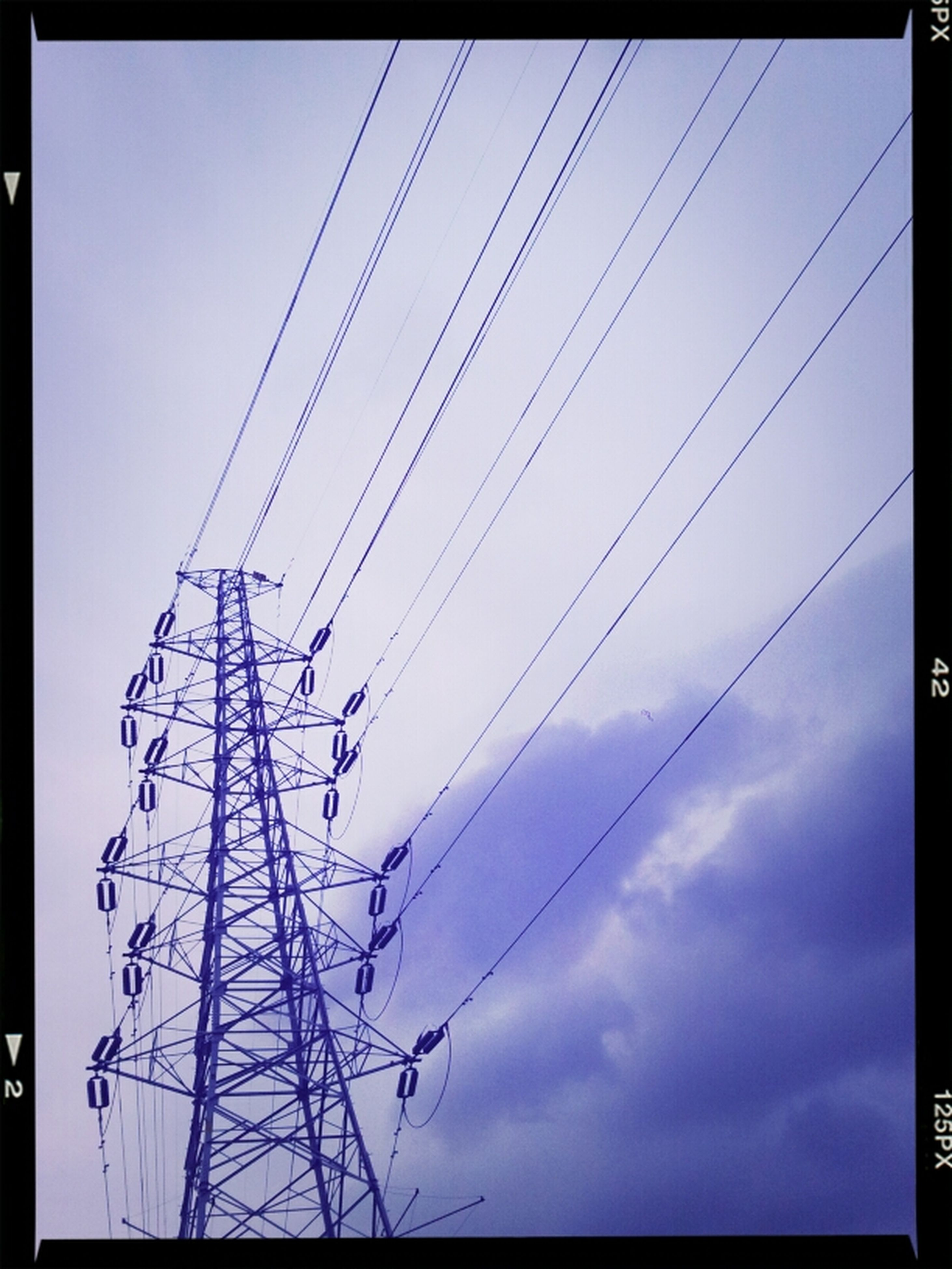 low angle view, power line, electricity pylon, power supply, electricity, transfer print, connection, cable, sky, auto post production filter, technology, fuel and power generation, silhouette, cloud - sky, blue, power cable, outdoors, day, no people, cloud