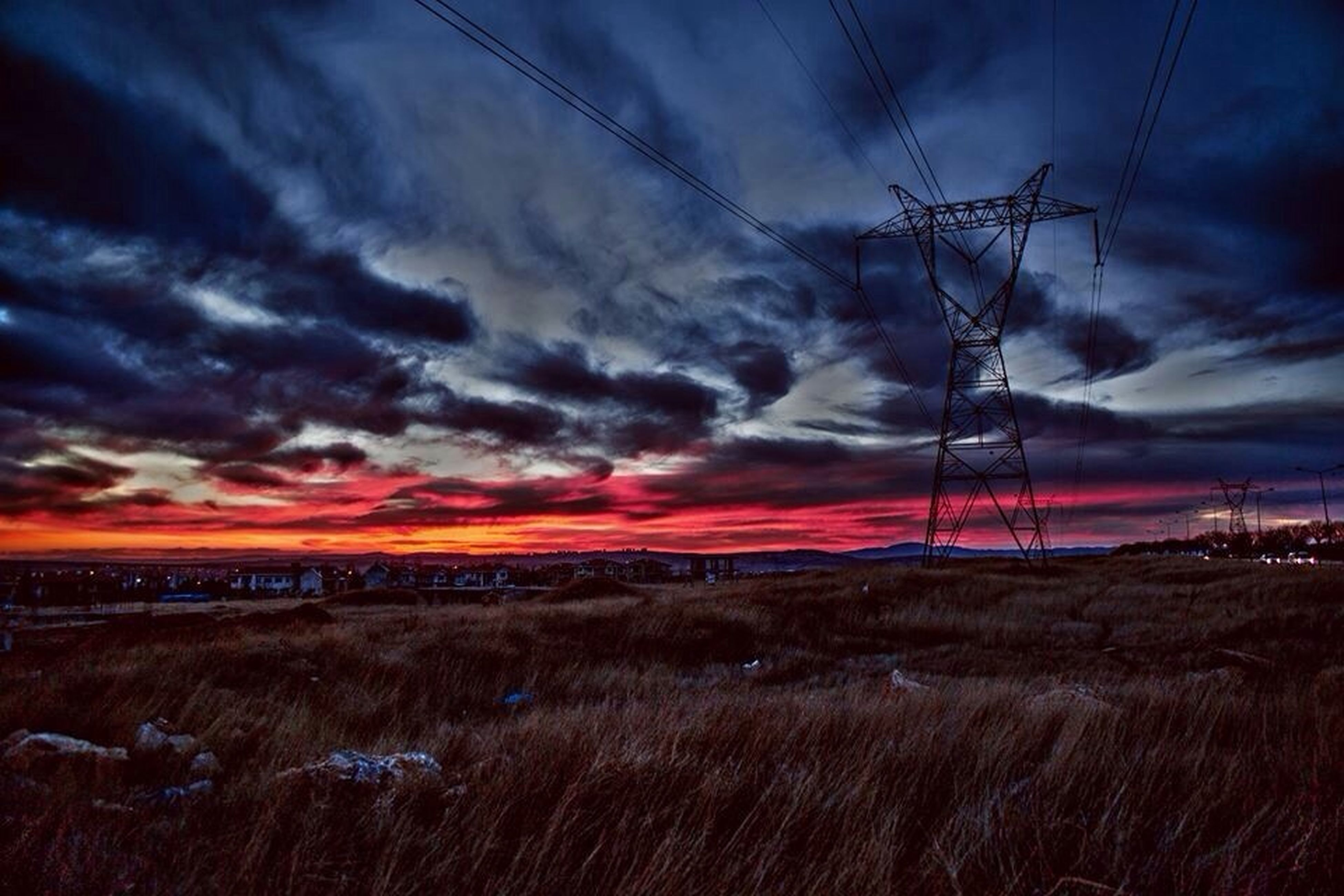 sky, cloud - sky, landscape, power line, sunset, tranquil scene, tranquility, scenics, field, electricity pylon, cloudy, beauty in nature, cloud, nature, electricity, dramatic sky, rural scene, power supply, fuel and power generation, idyllic
