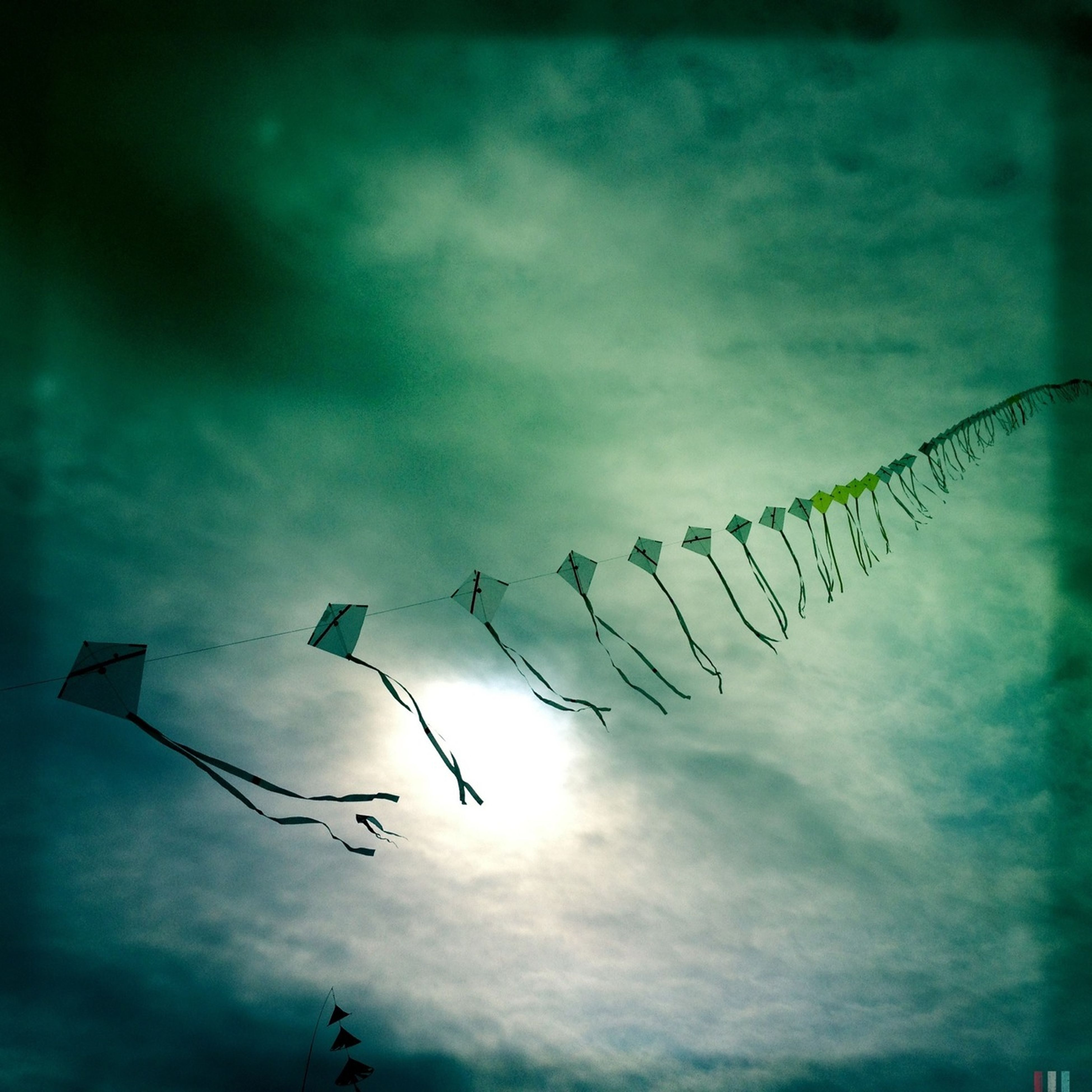 low angle view, sky, cloud - sky, cloudy, cloud, no people, hanging, outdoors, nature, in a row, blue, day, silhouette, dusk, lighting equipment, pole, protection, safety, multi colored, street light