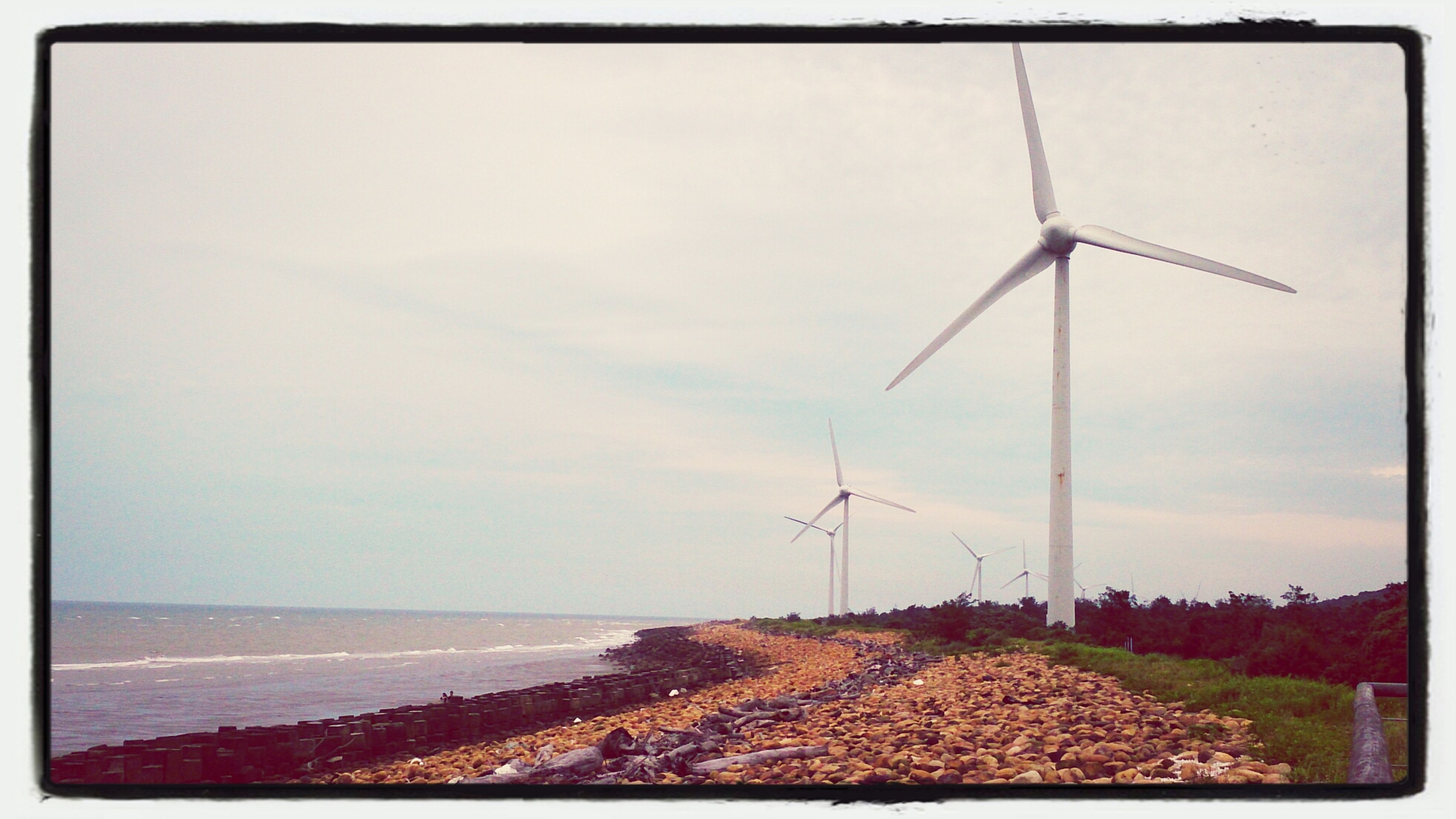 transfer print, sea, wind turbine, wind power, alternative energy, horizon over water, windmill, environmental conservation, water, auto post production filter, sky, beach, renewable energy, tranquil scene, tranquility, scenics, shore, landscape, fuel and power generation, nature