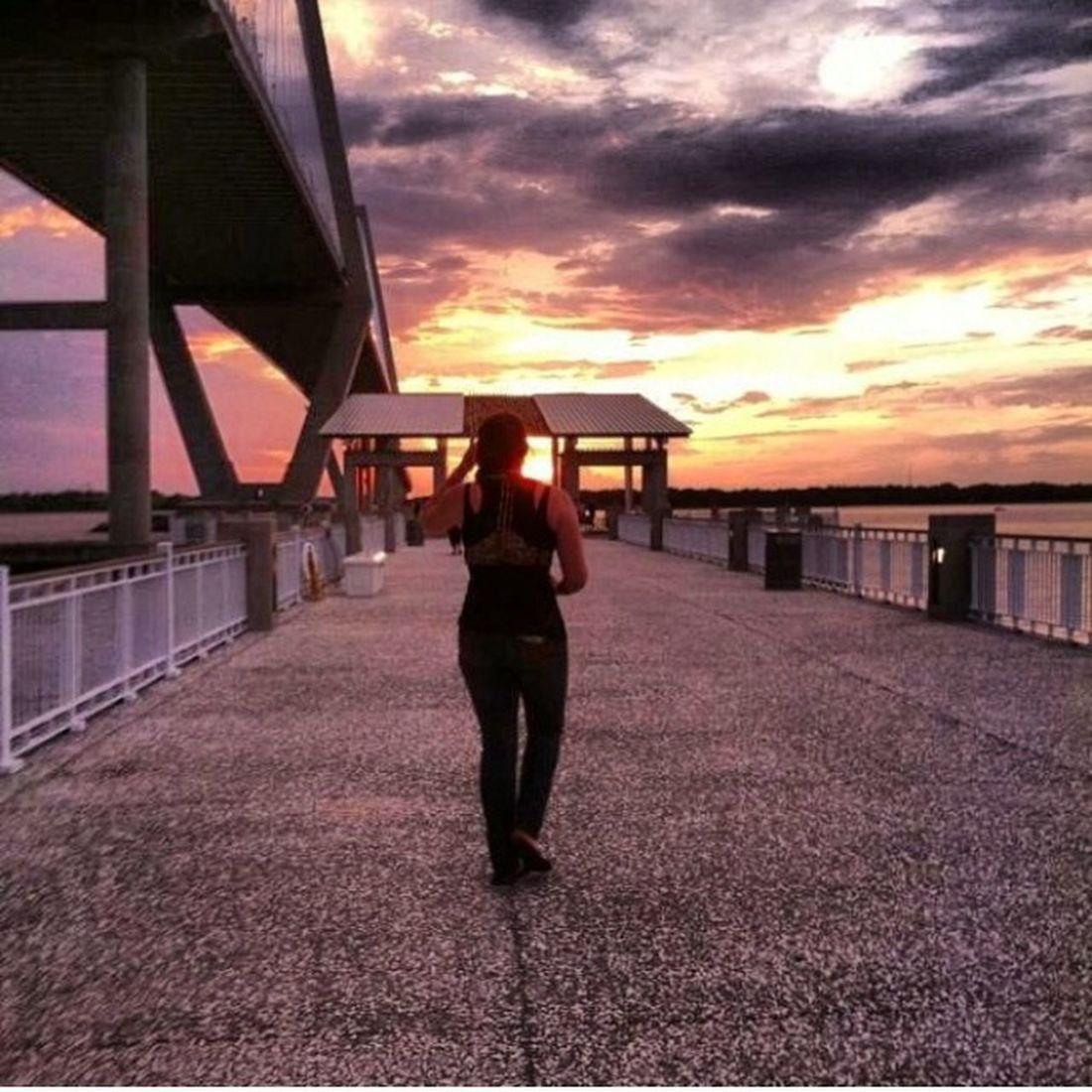 My best friend walking in front of me on the pier as the sun was setting Sunset Pier Best Friend