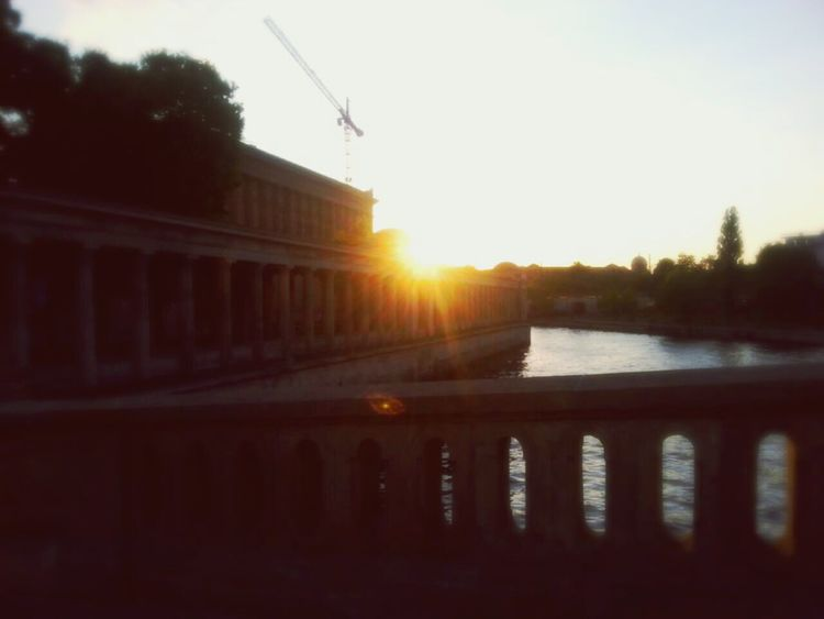 Battle Of The Cities Sunset Sun Water Built Structure Sunbeam City Life Berlin Bridge Places I've Been Smartphonephotography Place To Be  Places To Visit City Eyem Best Shots GERMANY🇩🇪DEUTSCHERLAND@ Enjoying Life Find My Way Myberlinweek Smartphone Photography Sunset Silhouettes Germany Embrace Urban Life Capture Berlin Sunset_collection The City Light Live For The Story Discover Berlin