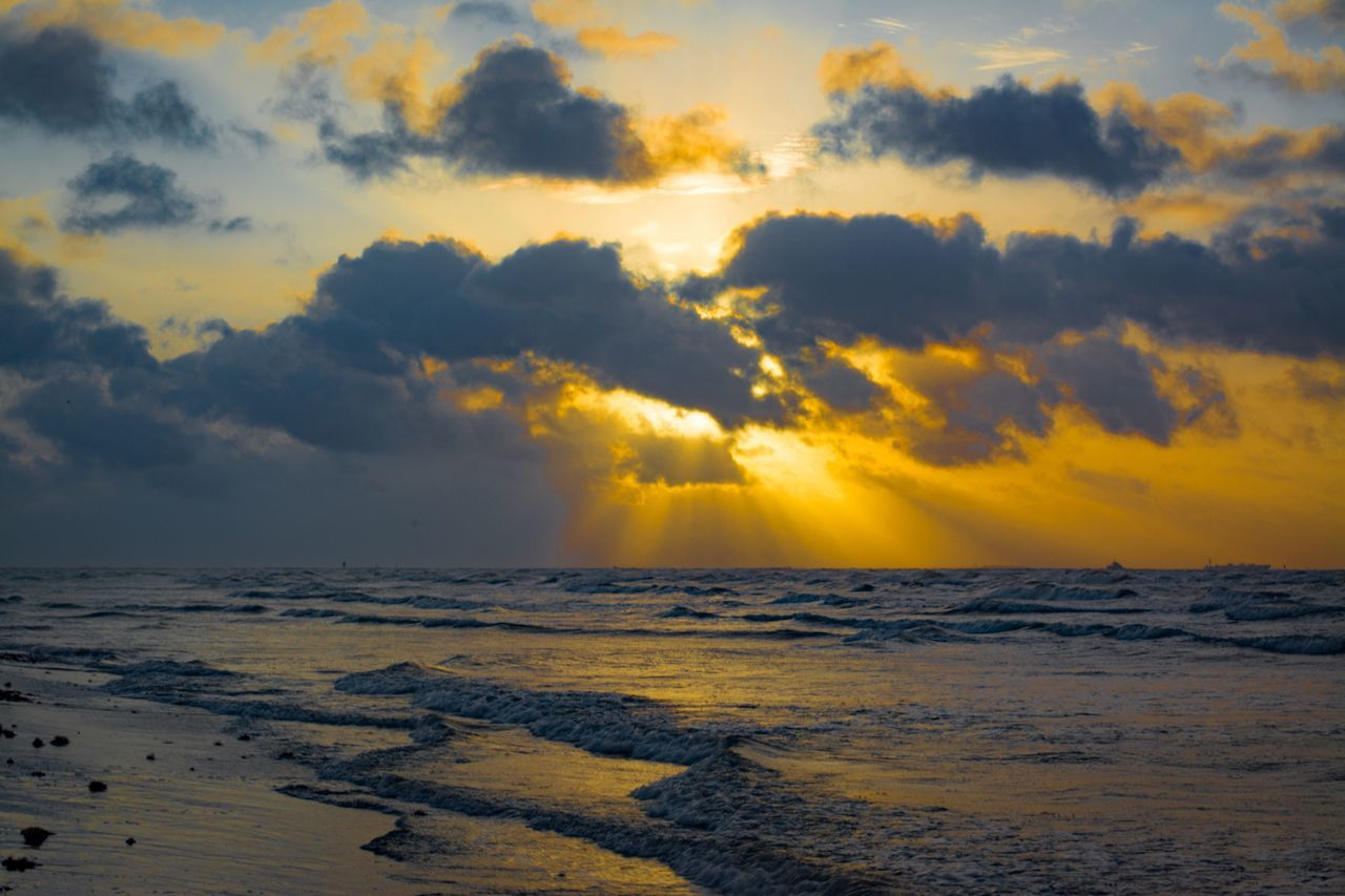 beauty in nature, nature, sunset, scenics, sea, sky, tranquility, tranquil scene, cloud - sky, outdoors, no people, water, horizon over water, beach, wave, yellow, day