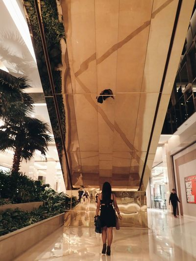 Solaire The Theater Gold Escalator Reflection Wonder Sister Black Dress Boots Olympus TG-4 WickedTheMusical Philippines Last Show Evening Indoors  The Secret Spaces EyeEm Diversity The Week On EyeEm