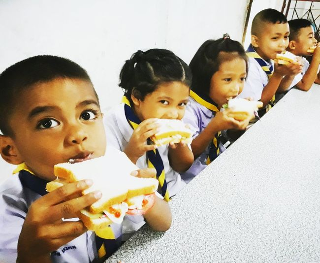 Child Childhood Girls Boys Looking At Camera Portrait Adult People Women Men Sitting Day Eating Togetherness Females Indoors  Close-up Young Adult Firstsandwich
