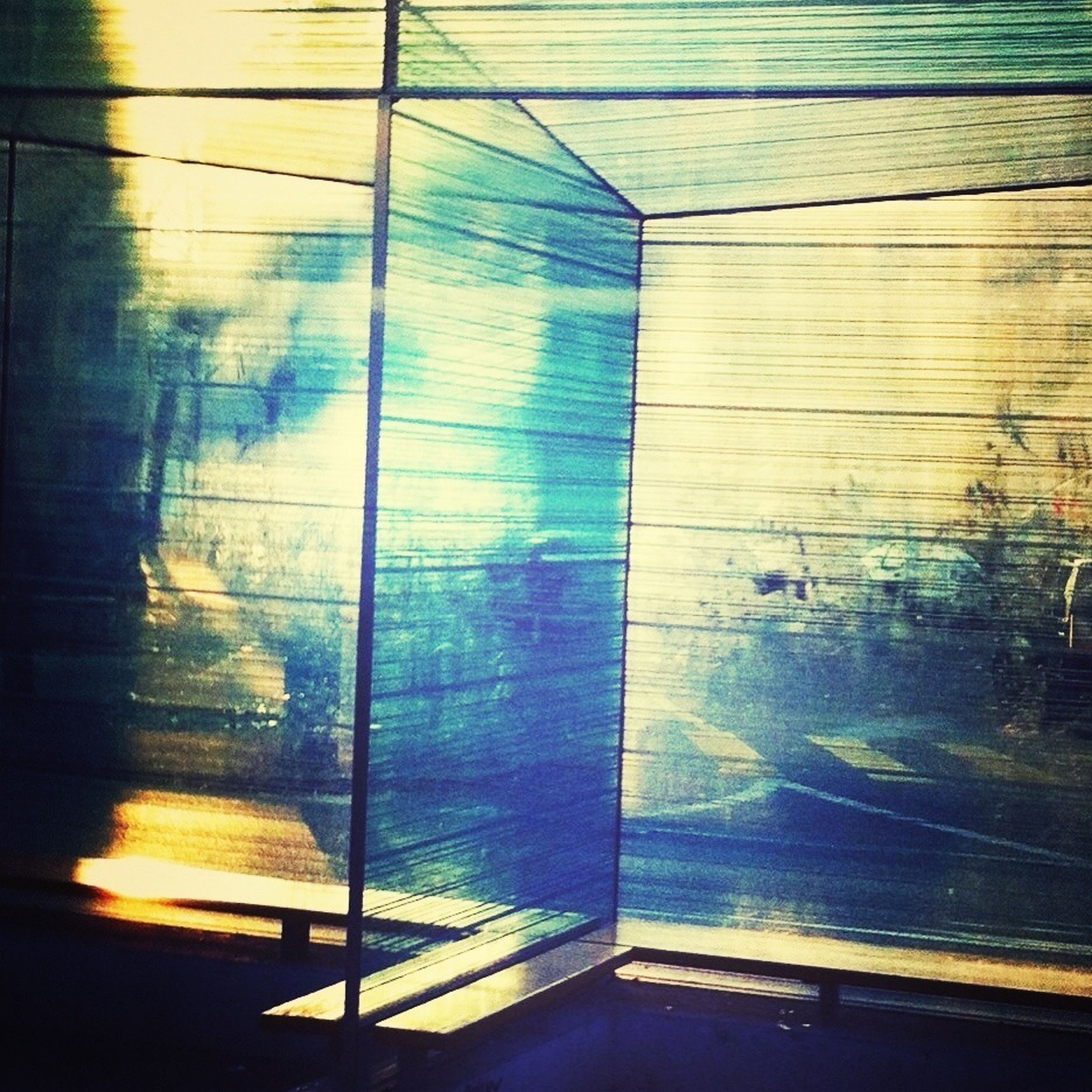 indoors, window, reflection, sunlight, wall - building feature, glass - material, built structure, transparent, curtain, wood - material, shadow, architecture, house, closed, no people, wall, day, door, home interior, water
