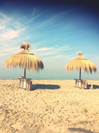 Sommergefühle EyeEm Selects Beach Sand Sea Vacations Summer Beauty In Nature Tranquility Outdoors Horizon Over Water Thatched Roof Tranquil Scene Nature Shore Scenics Sky Day Water No People Spain;