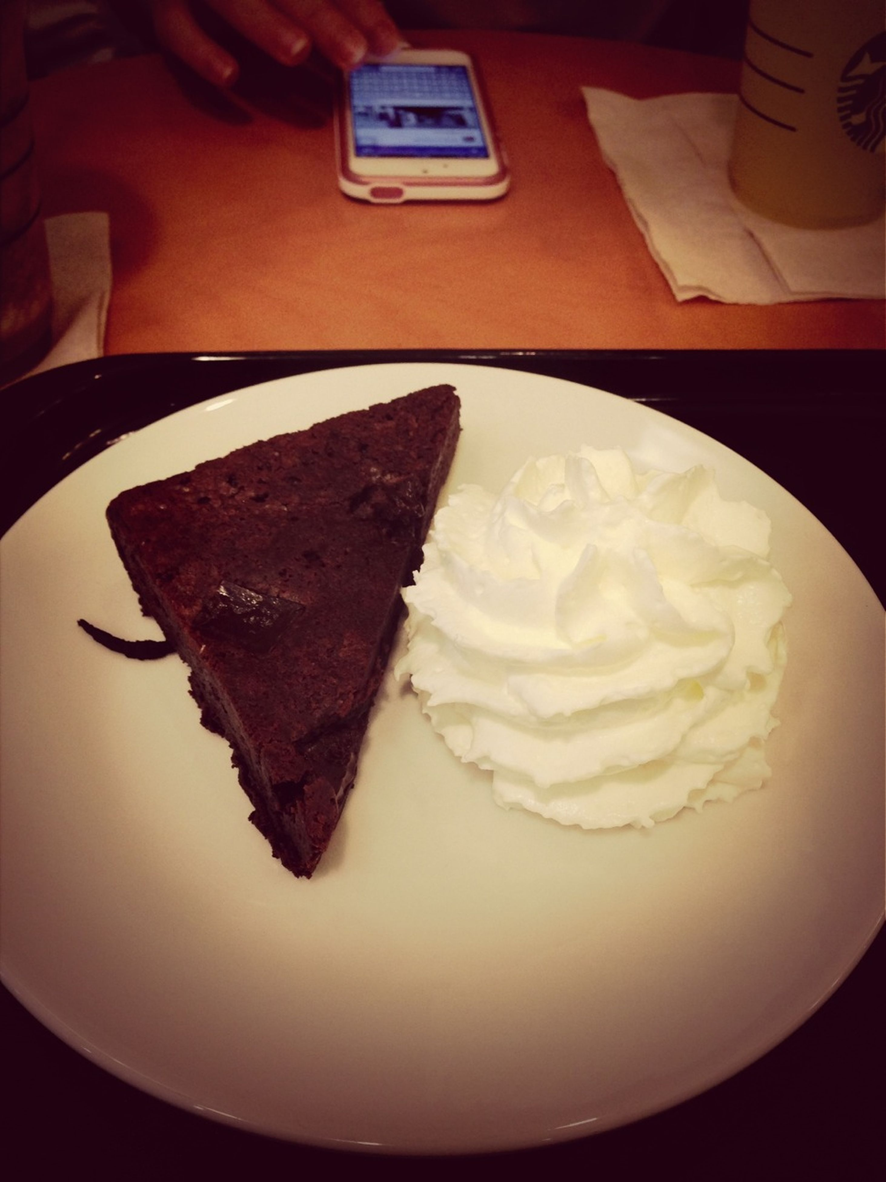 indoors, sweet food, food and drink, food, dessert, freshness, indulgence, ready-to-eat, unhealthy eating, still life, cake, close-up, temptation, high angle view, plate, table, chocolate, pastry, no people, cream
