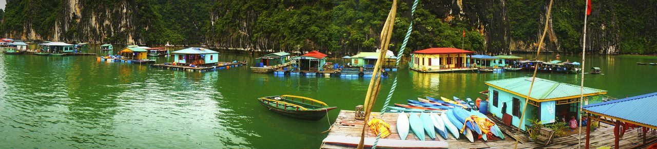 Ha Long Bay Natural Wonder Floatingvillage Floating House Vietnam Green Water Taking Photos Check This Out Amazing Architecture Cool South East Asia Follow Panoramic Followme Panorama Daytime Travel Islands Island Life Green Water Green Color Blue Boats Houseboat