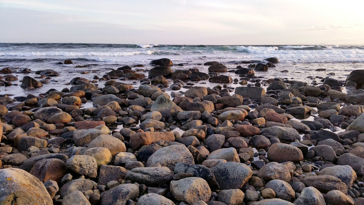 EyeEm Selects Sea Beach Pebble Horizon Over Water Nature Sunset Water Beauty In Nature Rock - Object Wave Pebble Beach Tranquility Outdoors No People Tranquil Scene Water's Edge Sky Travel Destinations Vacations Sand Norway Norway🇳🇴