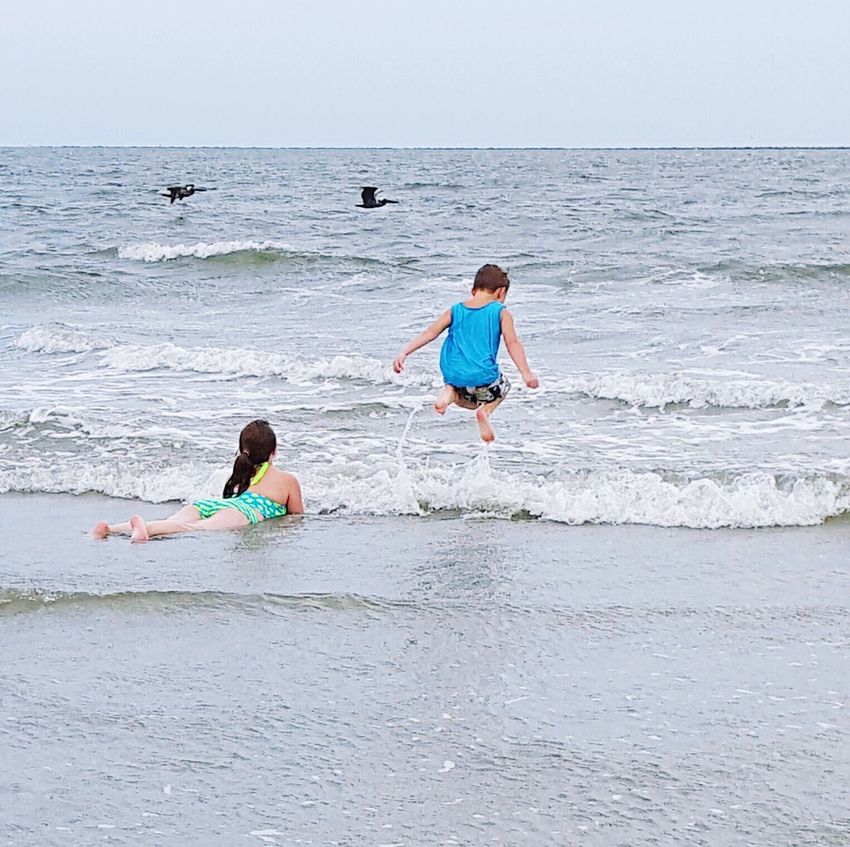 Water Childhood Leisure Activity Beach Vacations Rippled Fun Togetherness Sea Horizon Over Water Jumping Water