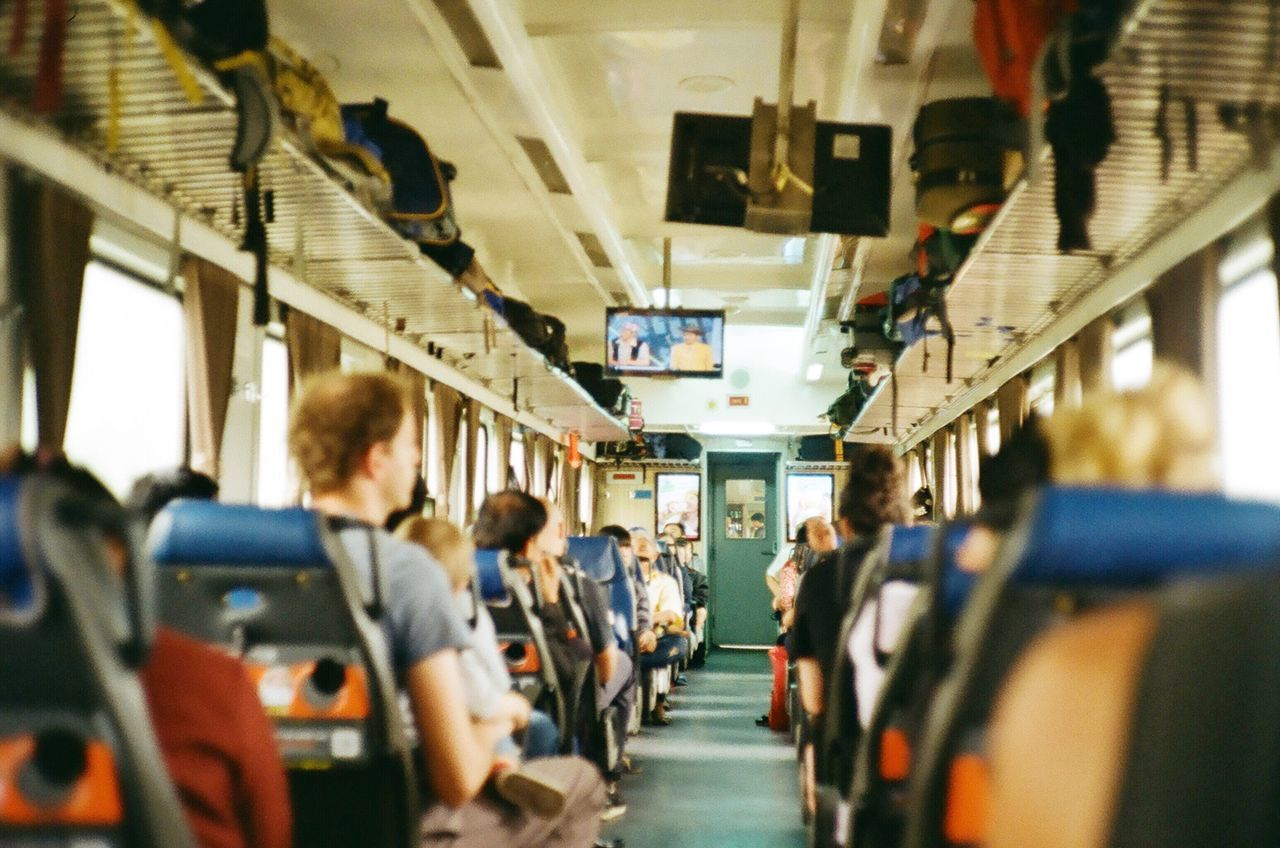 Film Filmisnotdead Analogue Photography Vietnam Holiday Vacations Train Transportation Travel Journey Mode Of Transport Passenger Vehicle Interior Large Group Of People Lifestyles Public Transportation Men Real People Indoors  Vehicle Seat Day