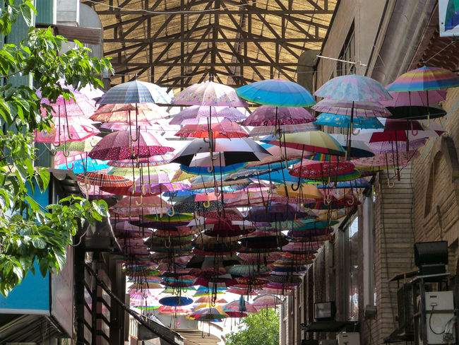Architectural Feature Architecture Arrangement Building Exterior Built Structure Choice Collection Day For Sale Group Of Objects Hanging In A Row Iran Large Group Of Objects Market Multi Colored No People Outdoors Persian Repetition Retail  Umbrella Variation