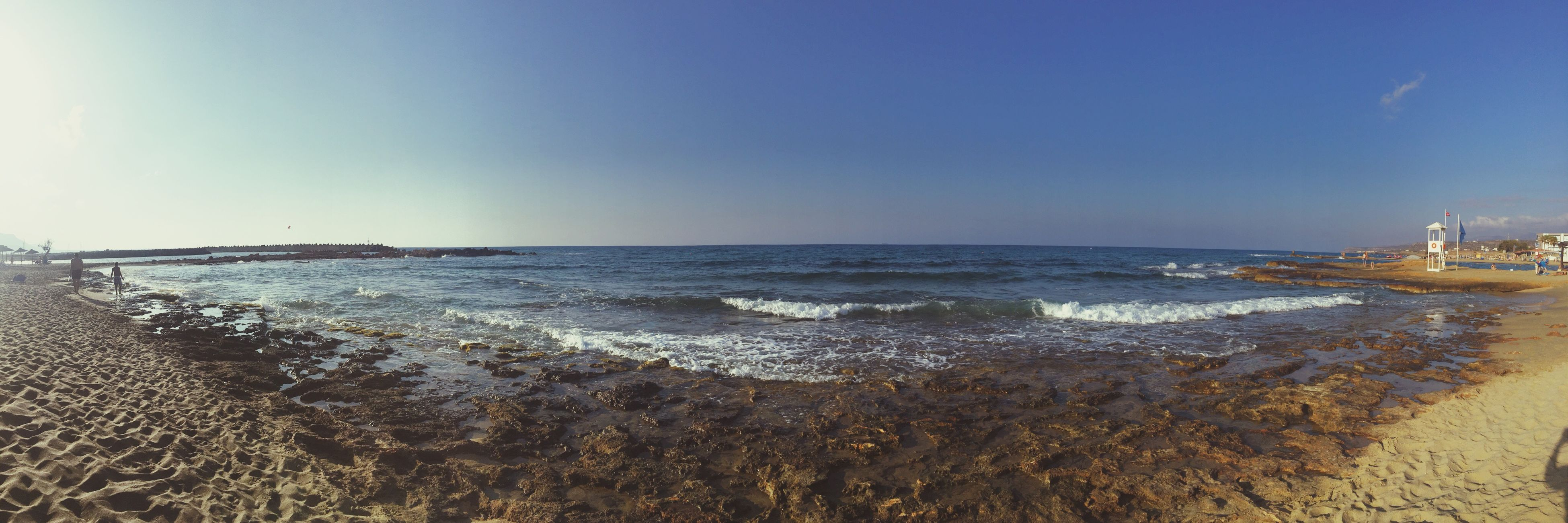 sea, horizon over water, water, panoramic, beach, clear sky, scenics, tranquil scene, shore, copy space, blue, tranquility, beauty in nature, nature, calm, seascape, wave, coastline, day, majestic, sky, remote, non-urban scene, surface level, outdoors, ocean, no people, rocky, non urban scene, solitude