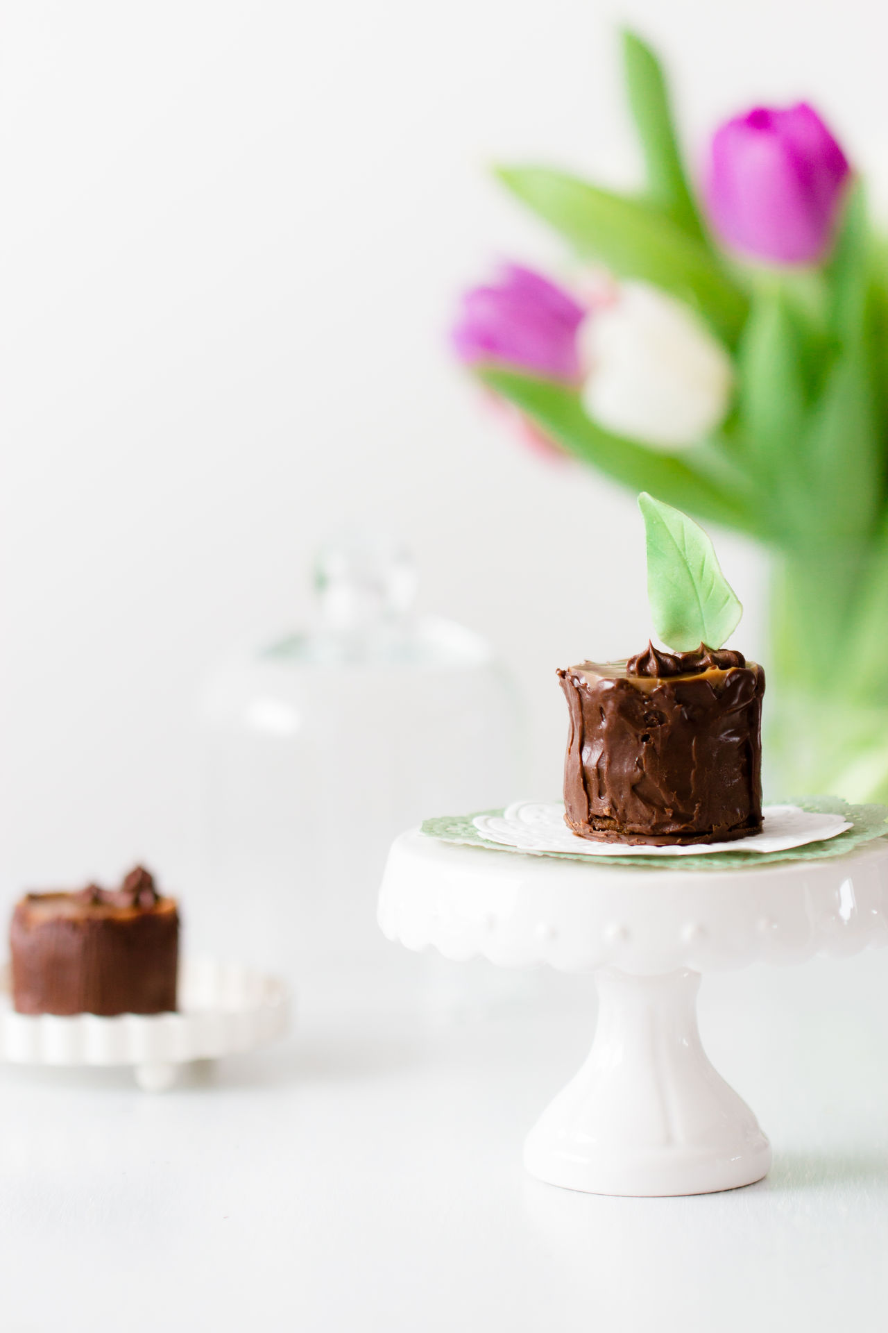 tiny chocolate cakes on white table Cake Chocolate Close-up Day Dessert Flower Food Food And Drink Freshness Indoors  Indulgence No People Plate Ready-to-eat Sweet Food Table Temptation Unhealthy Eating