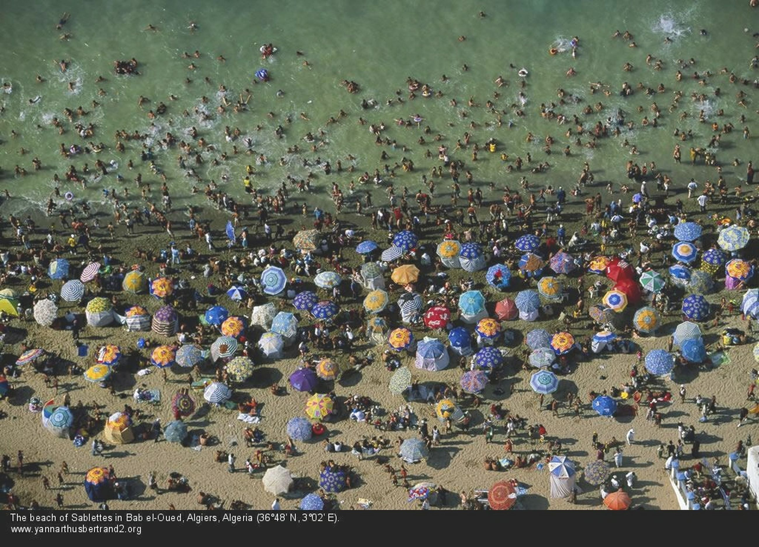 high angle view, indoors, water, abundance, large group of people, large group of objects, cityscape, crowded, city, multi colored, leisure activity, built structure, sea, variation, lifestyles, crowd, building exterior, day