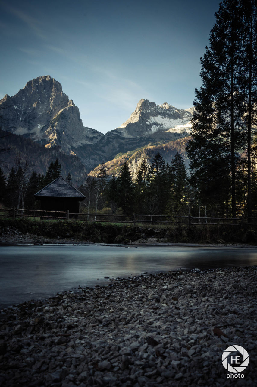 mountain, beauty in nature, nature, scenics, sky, mountain range, no people, tranquil scene, tranquility, outdoors, tree, day, water