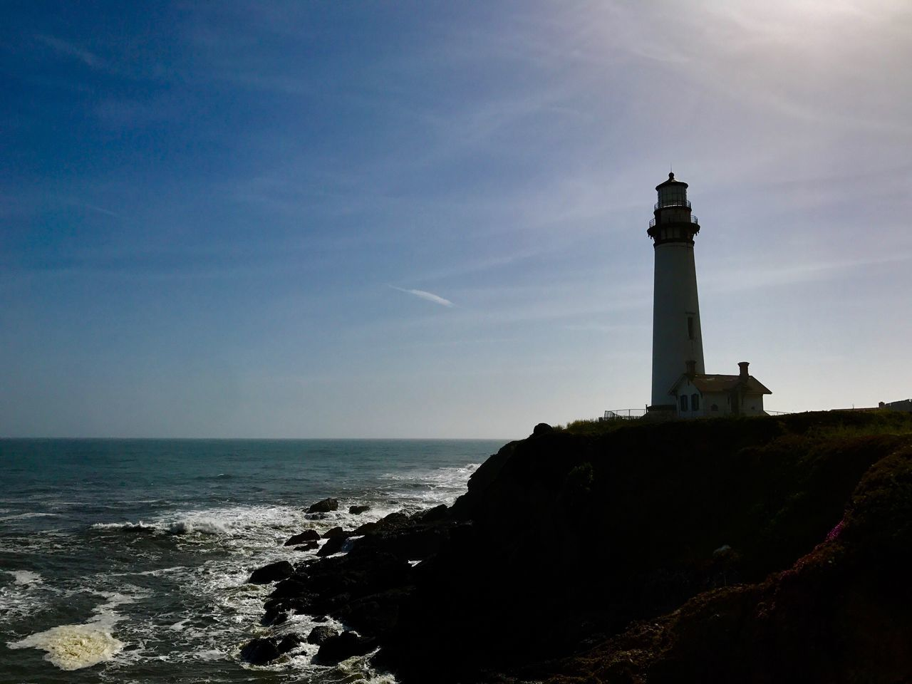 lighthouse, sea, guidance, architecture, horizon over water, safety, direction, sky, protection, nature, built structure, building exterior, water, beauty in nature, scenics, beach, cliff, outdoors, no people, day